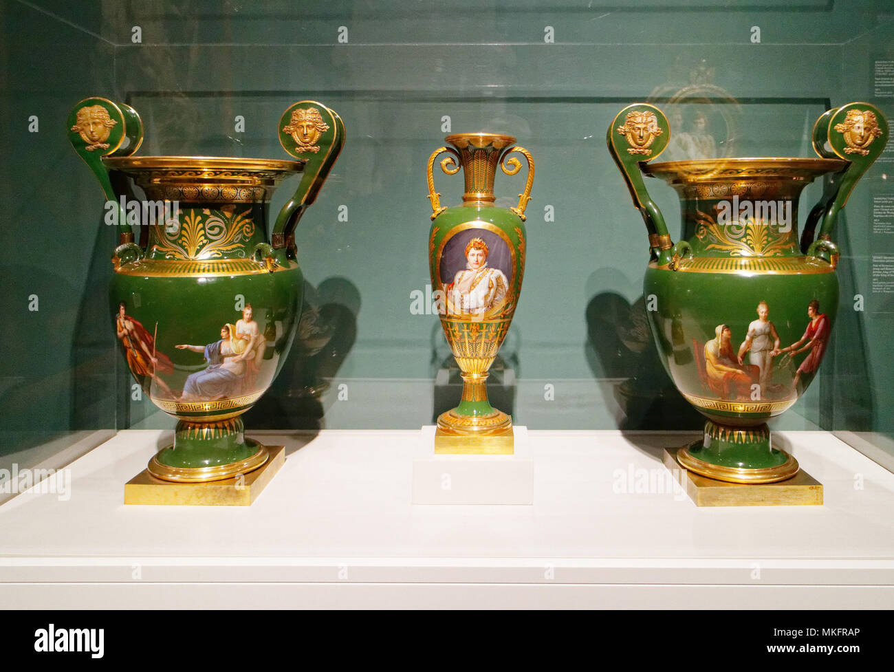 Napoleon's portrait painted on a Sèvres porcelain spindle vase and a pair of Etruscan scroll vases - Stock Image