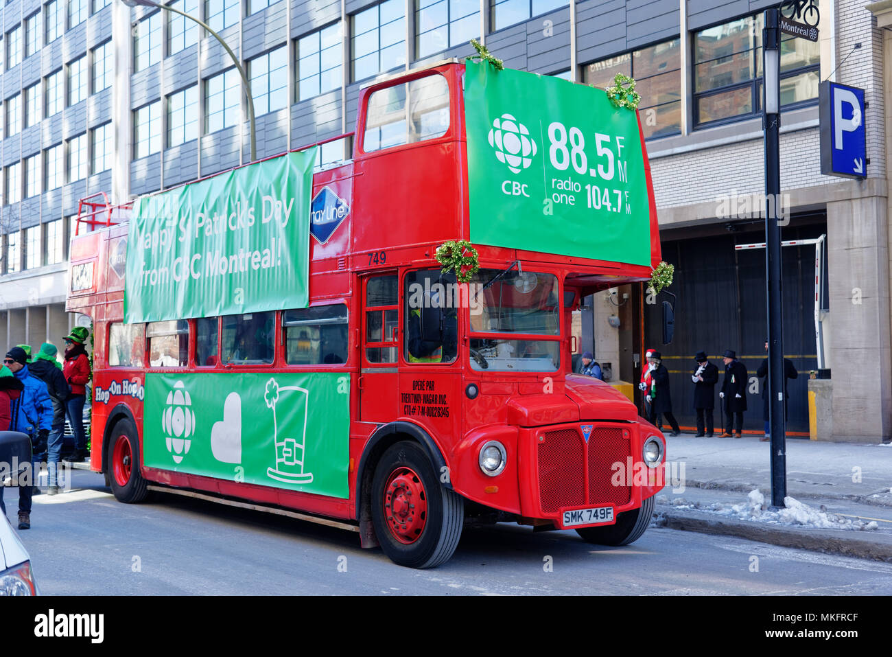 A Routemaster red double decker bus in Montreal in the St Patrick's Day parade - Stock Image