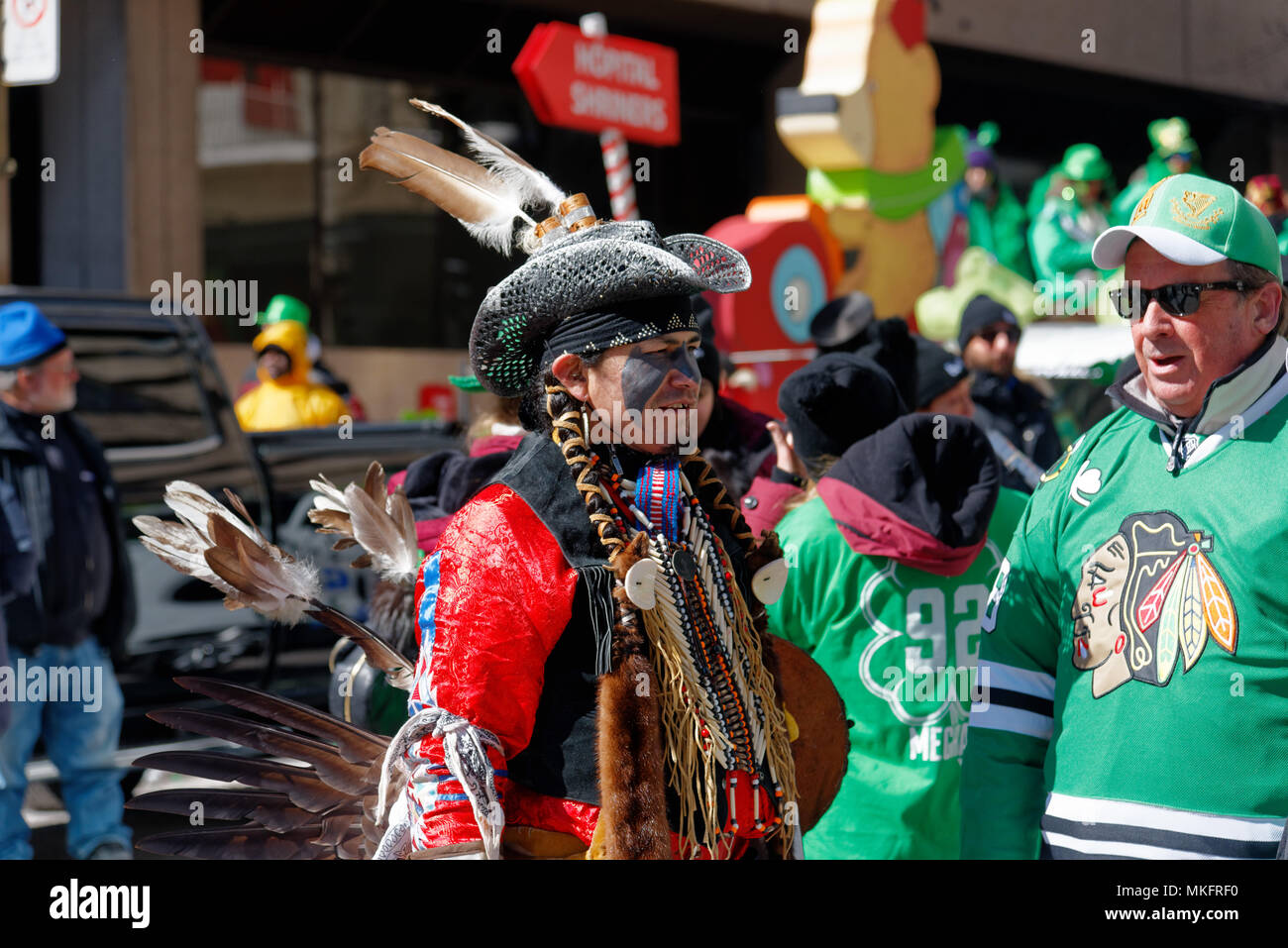 An Amerindian in full Mohawk costume at Montreal St Patrick's Day Parade - Stock Image