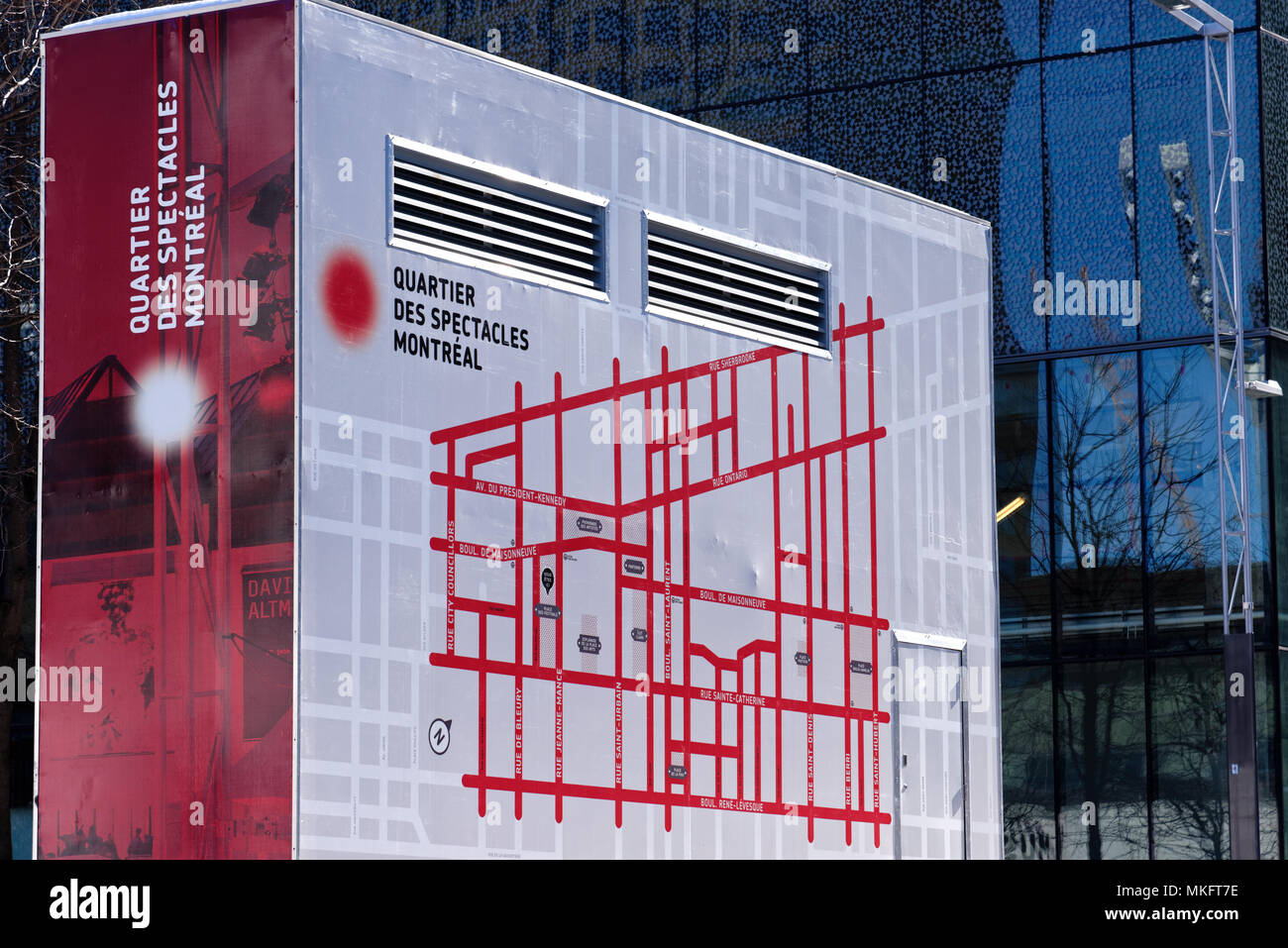 A map of Montreal's Quartier des Spectacles (entertainment district) painted on anaircon unit - Stock Image