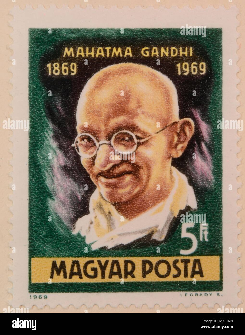Mahatma Gandi, the leader of India's non-violent independence movement, portrait on a Hungarian stamp - Stock Image