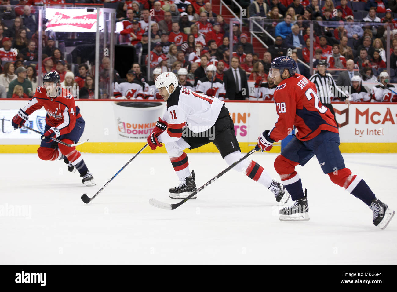 New Jersey Devils center Brian Boyle (11) carries the puck while chased by Washington Capitals defenseman Jakub Jerabek (28). Stock Photo