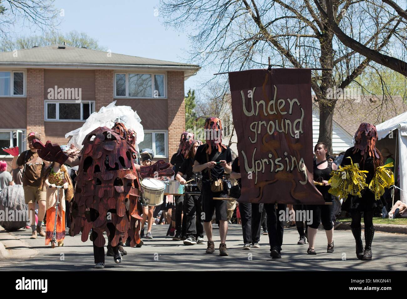 People dressed as hazardous waste, at the May Day festival in Minneapolis, Minnesota, USA. - Stock Image