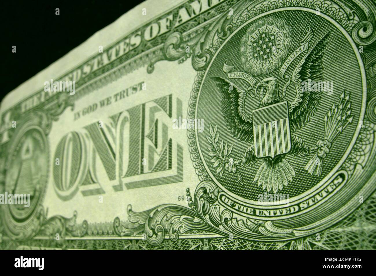 Low angle shot of the back of the US one dollar bill, featuring the American eagle. - Stock Image
