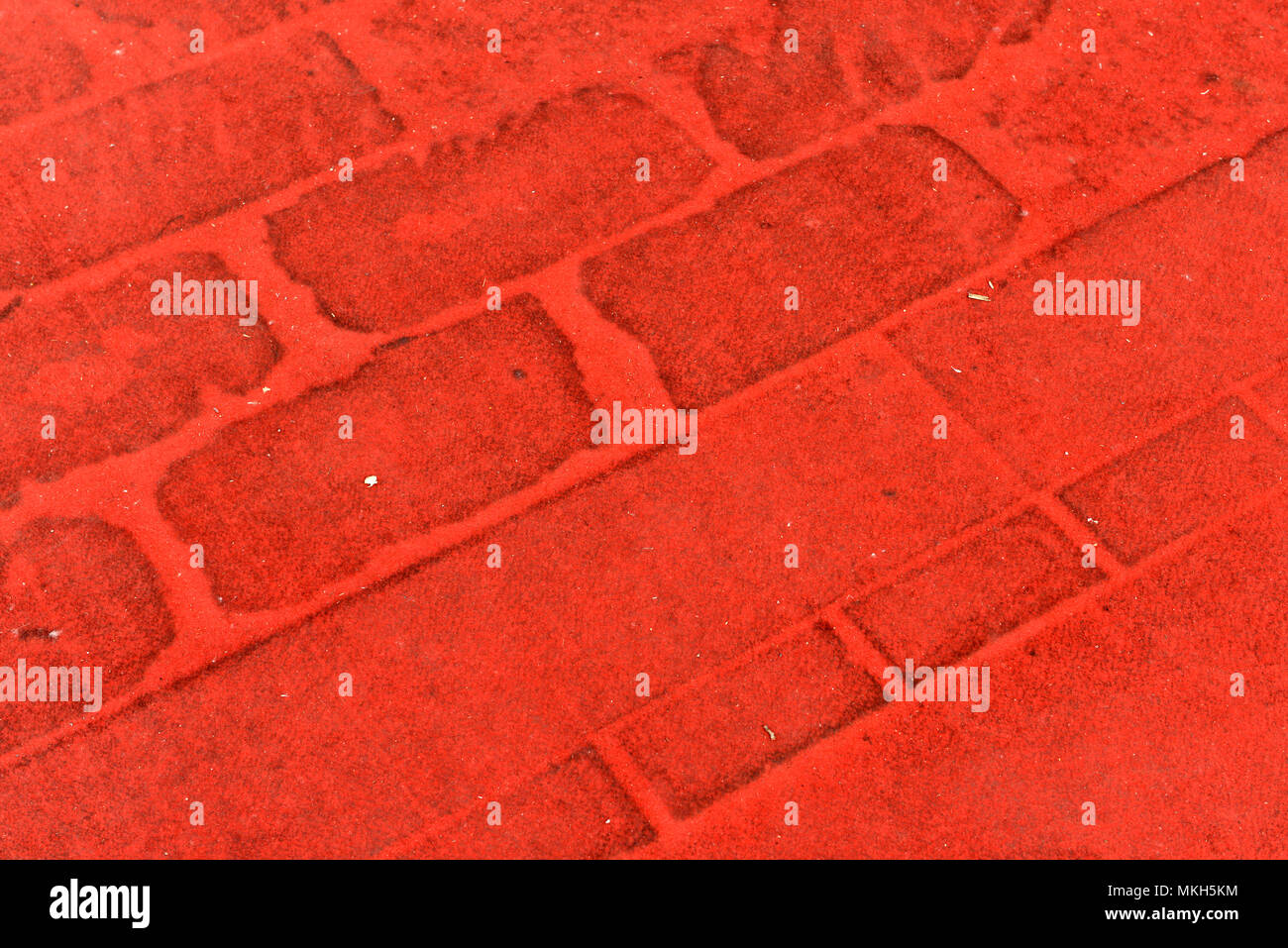 Red ground coverings seen in the outdoor display area at the China International Exhibition Center, new venue, location of the 2018 autoshow - Stock Image