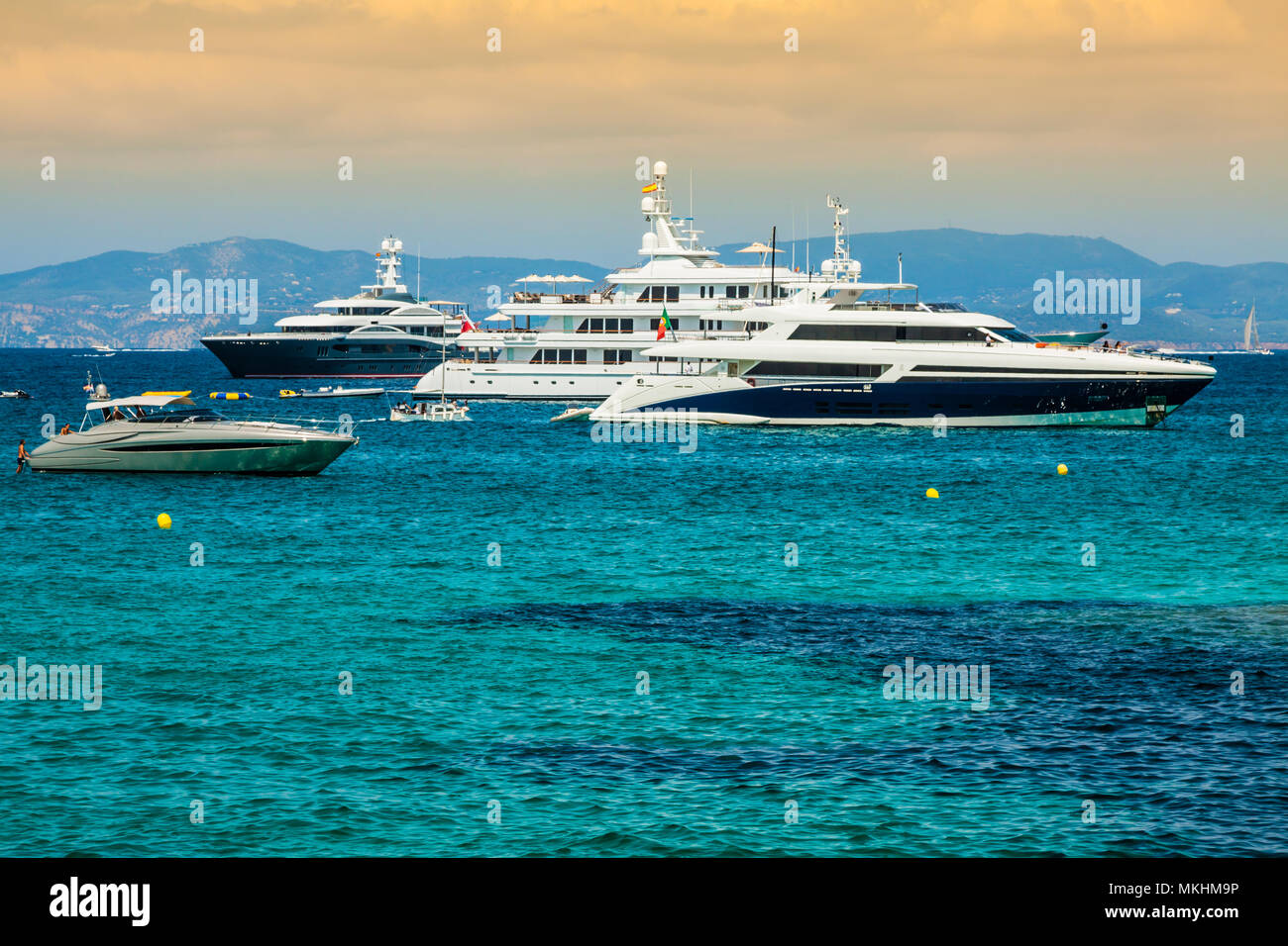 Luxury yachts in turquoise beach of Formentera Illetes - Stock Image