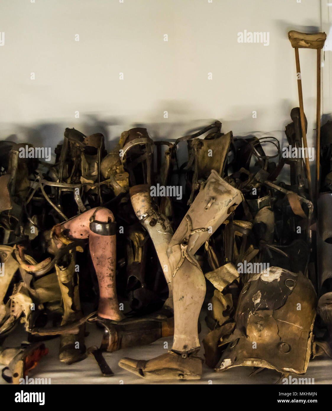 Collection of prosthesis removed from prisoners at Auschwitz, nazi concentration camp in Poland. - Stock Image
