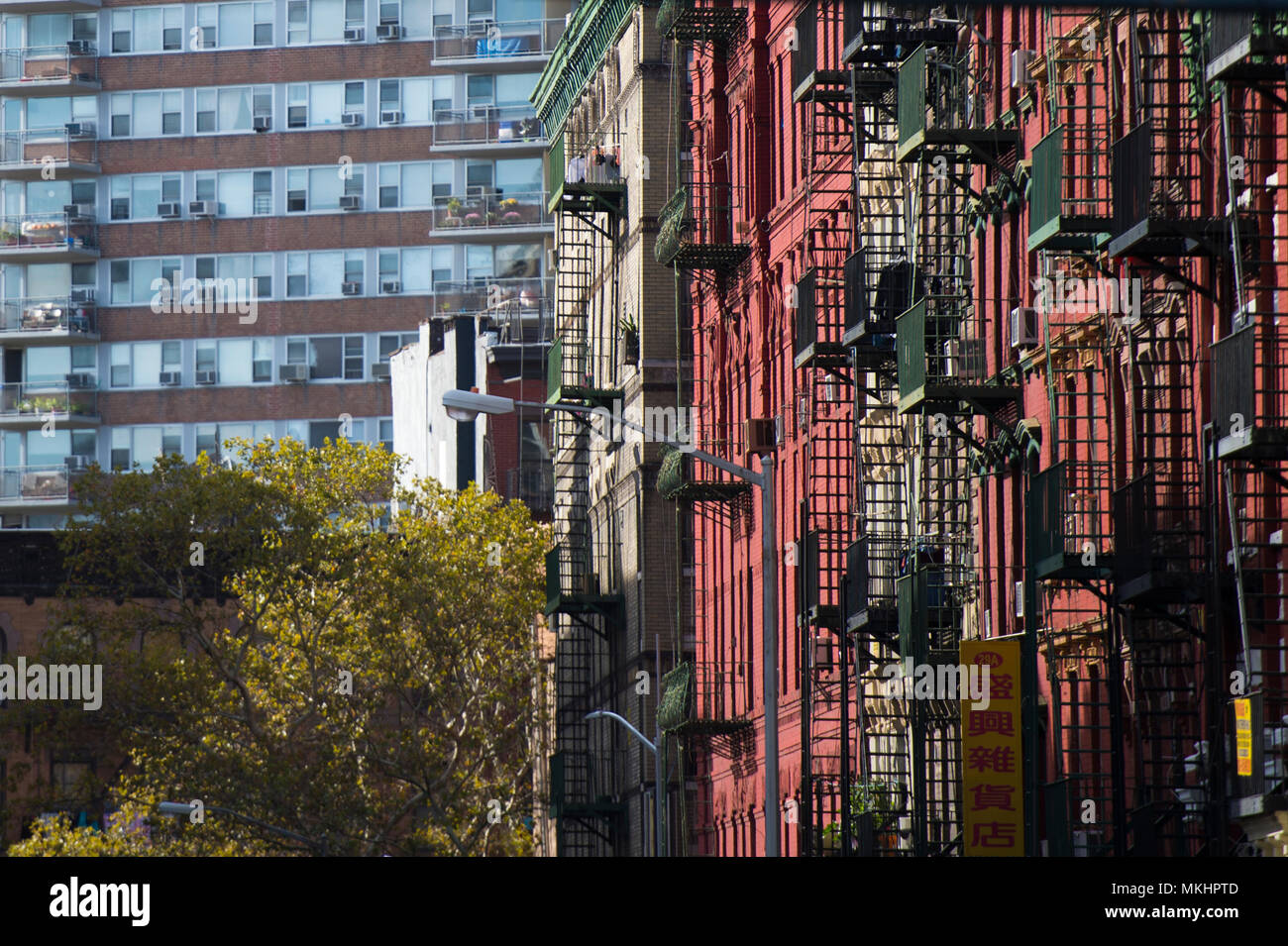 NEW YORK - USA- 28 OCTOBER 2018. Close-up view of New York City style apartment buildings with emergency stairs along Mott Street in Chinatown - Stock Image