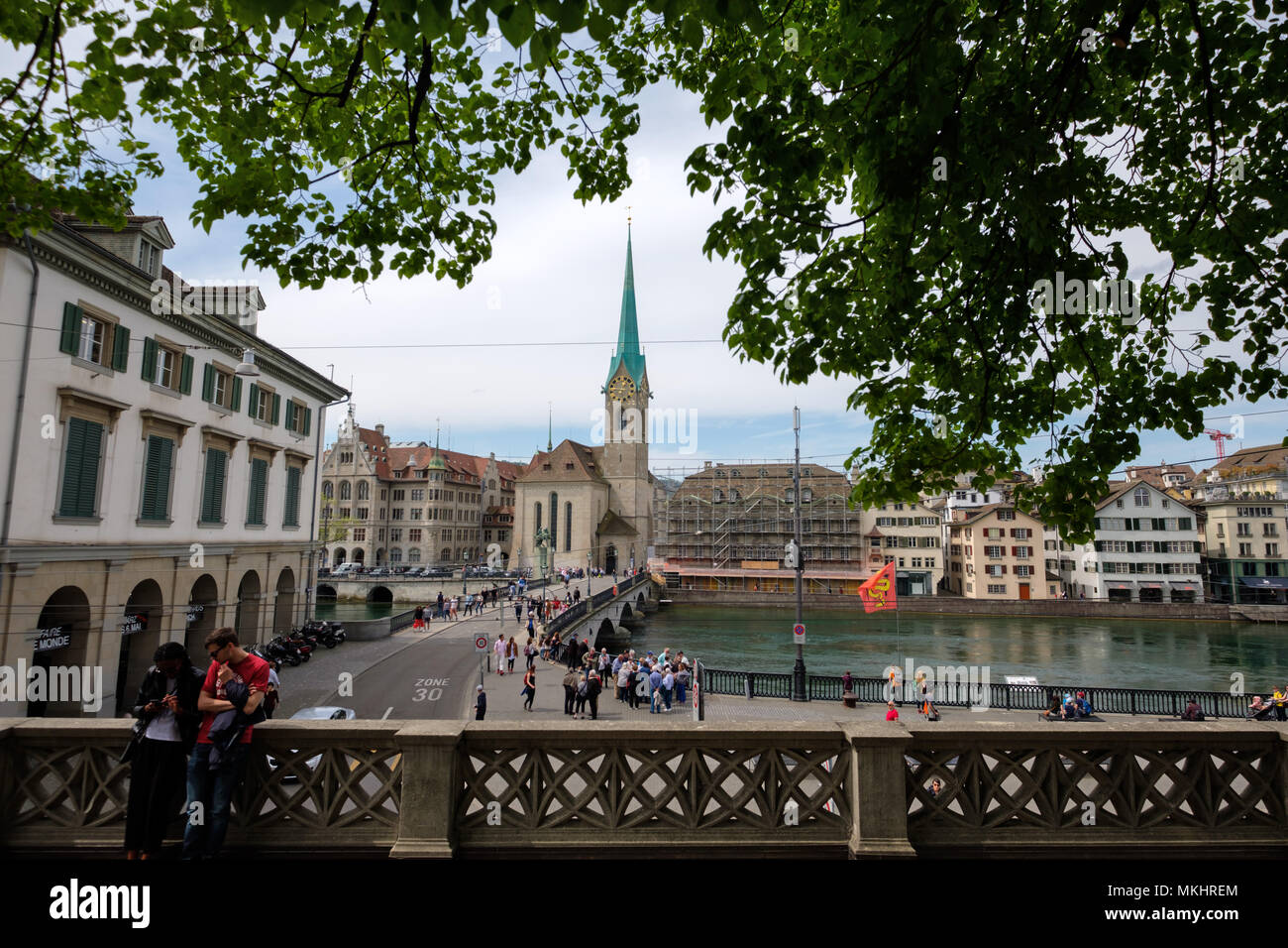 Wideangle view of the Münsterbrücke bridge over the Limmat river and the Fraumünster Church in Zurich, Switzerland, Europe - Stock Image