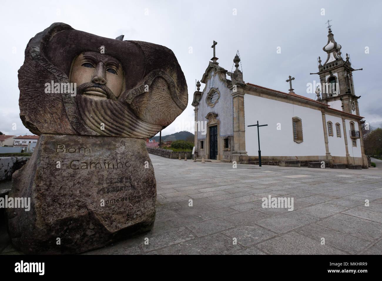 Sculpture honoring the pilgrims of the St. James way next to the Igreja de Santo António da Torre Velha catholic church in Ponte de Lima, Portugal Stock Photo