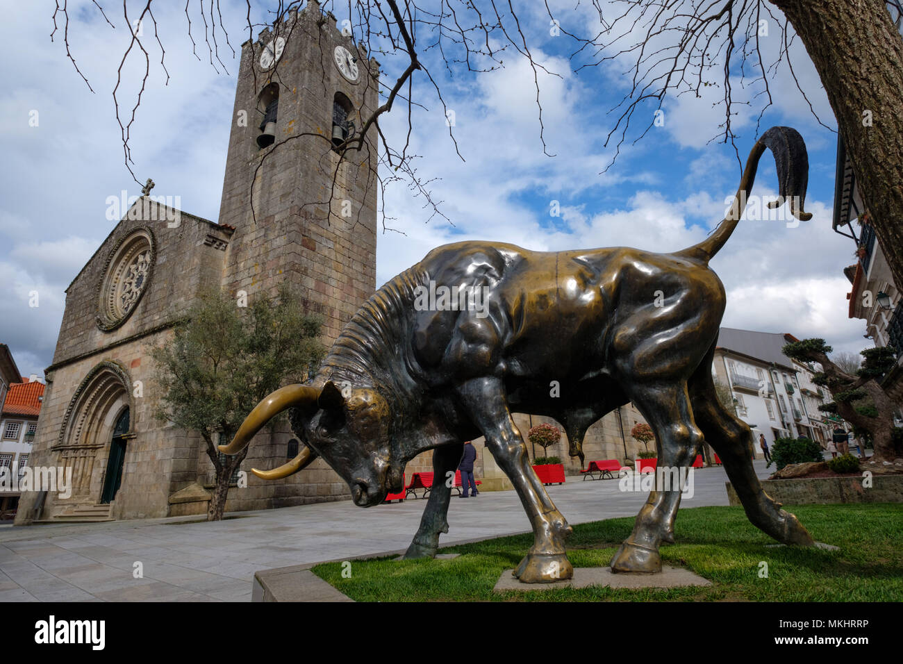 Bronze statue of a bull used during the Vaca das Cordas traditional festivities in front of the Igreja Matriz church in Ponte de Lima, Portugal - Stock Image