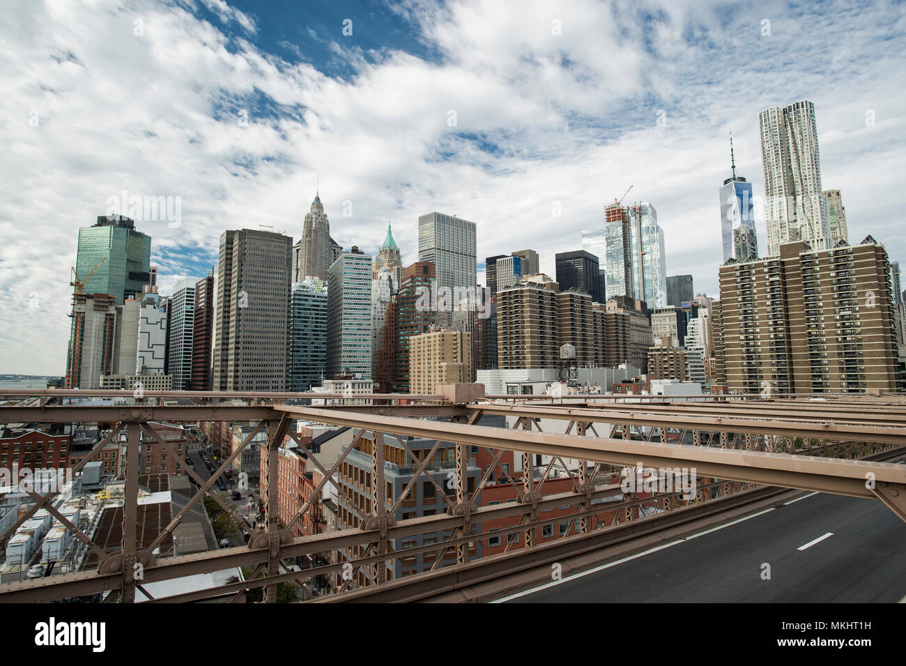 Manhattan skyline seen from the beautiful Brooklyn bridge. Cloudy day in New York City, USA. - Stock Image