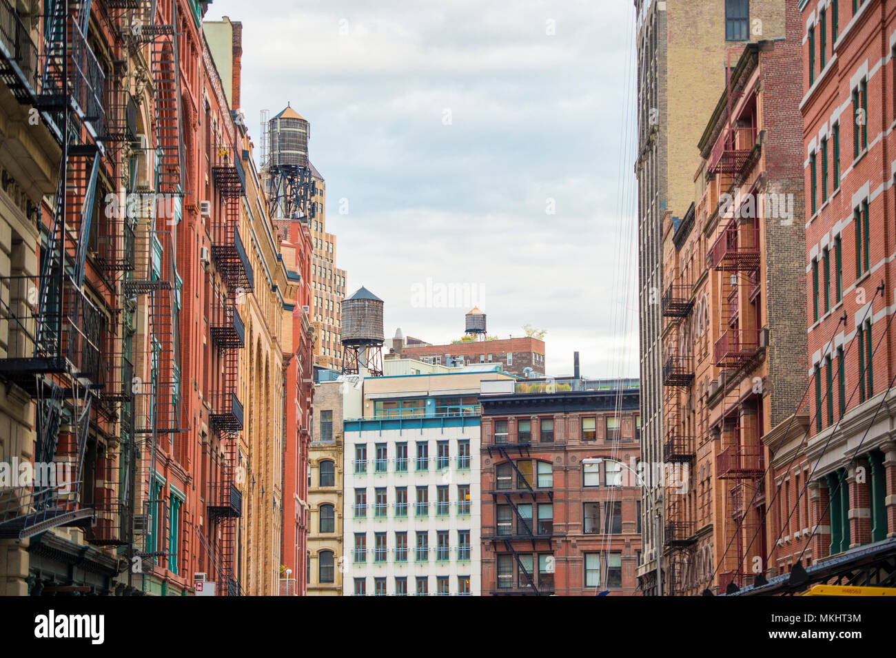 Close Up View Of New York City Style Apartment Buildings With Emergency  Stairs Along Mott Street In The Chinatown Neighborhood Of Manhattan NYC.
