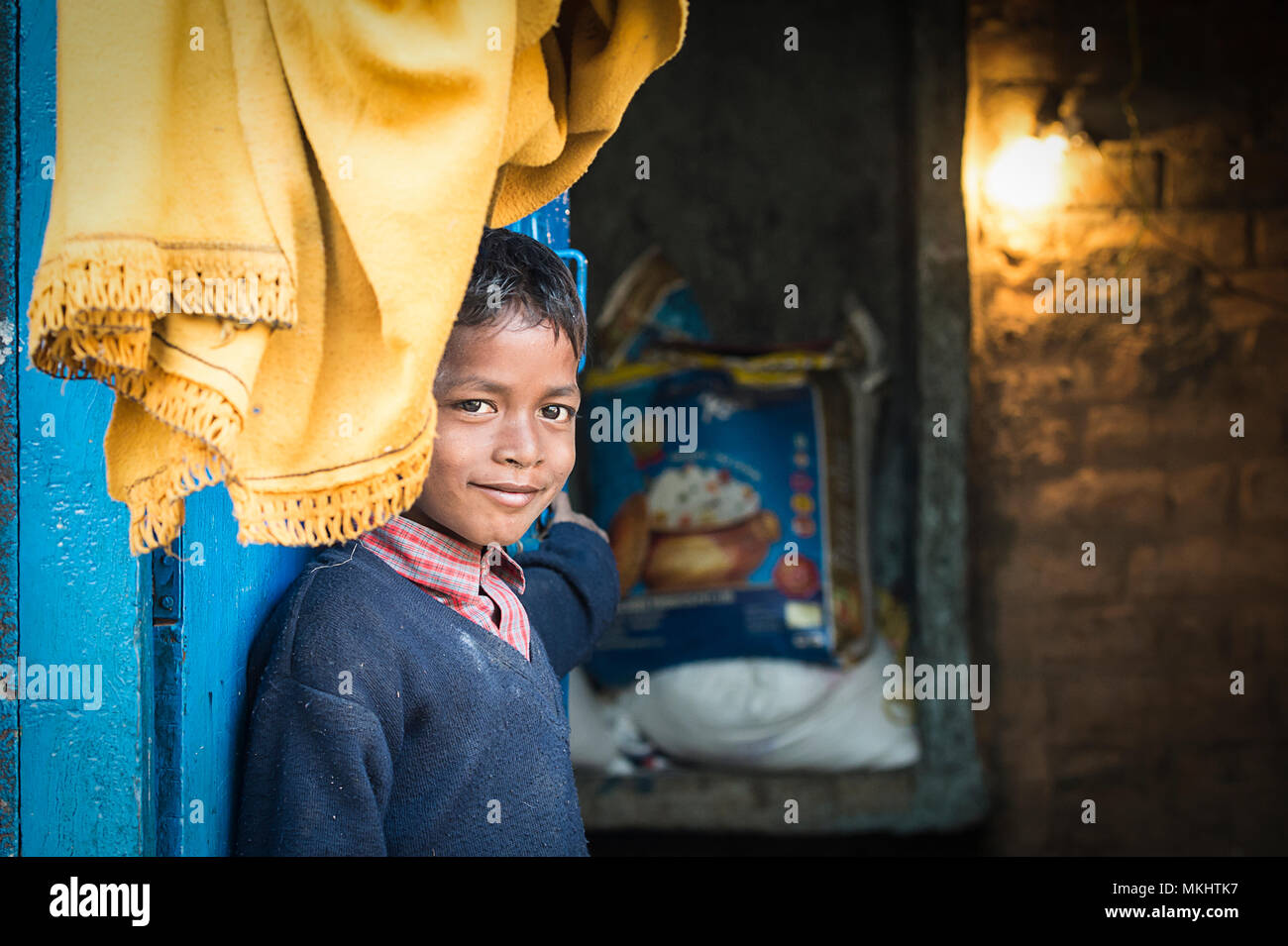 RAJASTHAN - INDIA - 06 JANUARY 2018. Portrait of a young boy in front of his small house. Picture taken from a rural village in Rajasthan. India. - Stock Image