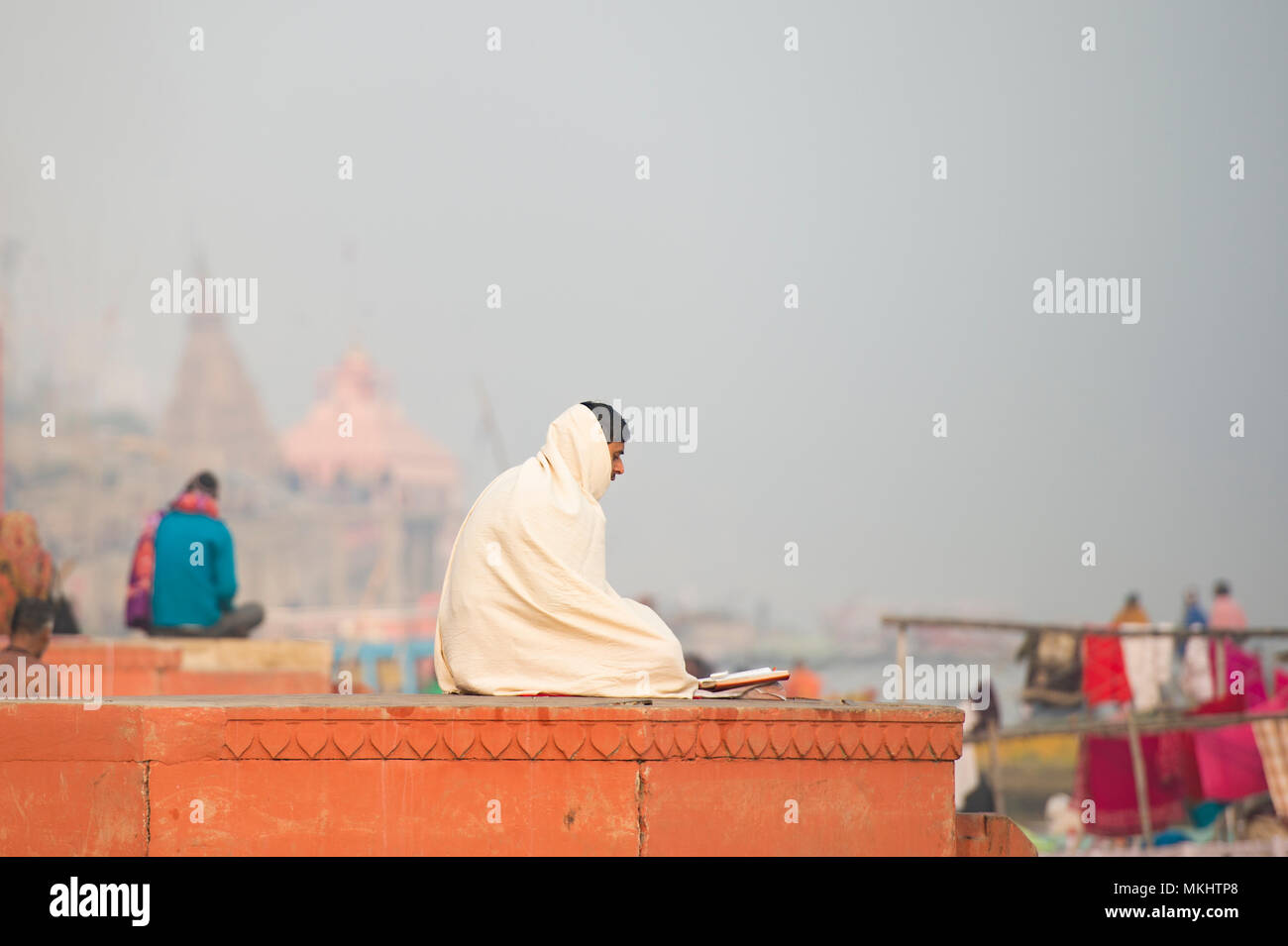 VARANASI - INDIA - 12 JANUARY 2018. Meditation, Holy man Sadhu meditating at the ghats of Varanasi, Banaras, Uttar Pradesh, India, Asia - Stock Image