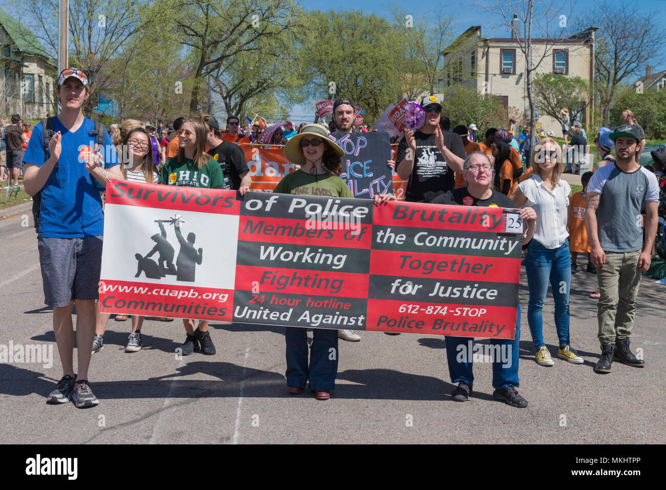 MINNEAPOLIS - May 6, 2018: Individuals proteting police brutality march in Minneapolis' yearly May Day parade. - Stock Image