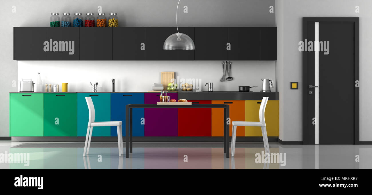 Colorful modern kitchen with dining table and chairs - 3d rendering Stock Photo