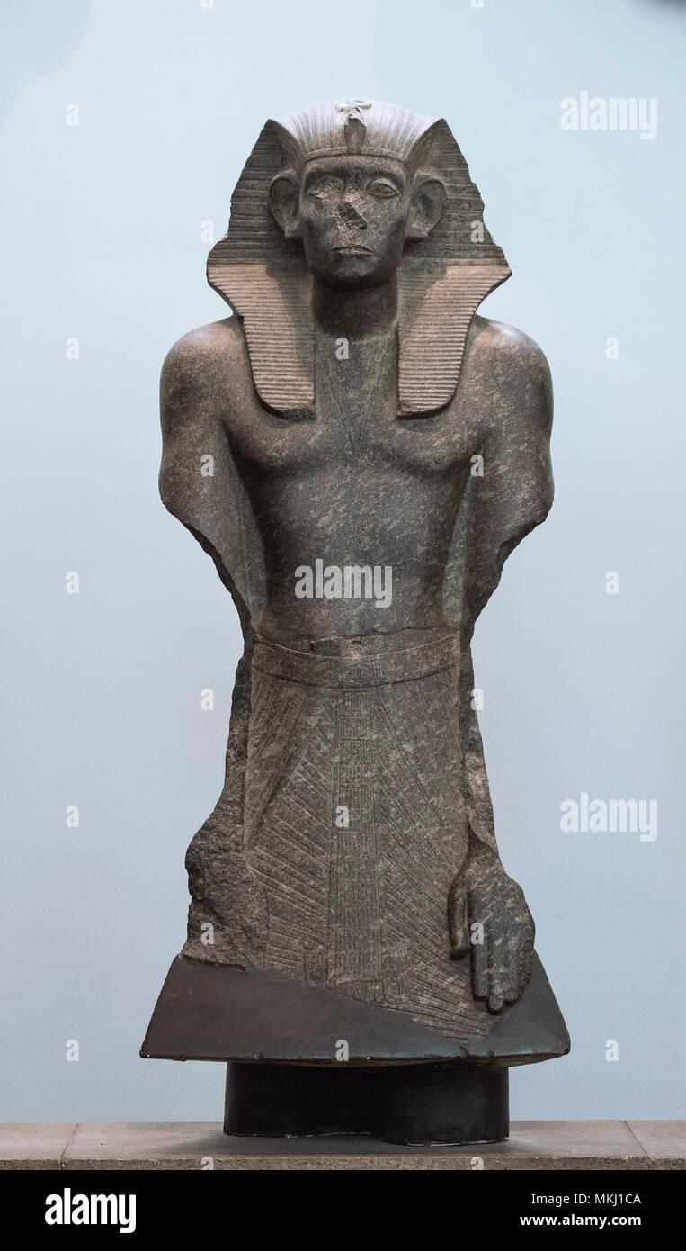 London. England. British Museum. Statues of Egyptian Pharaoh Senwosret III (or Senusret / Sesostris), wearing a nemes head cloth, ca. 1874-1855 BC, fr - Stock Image