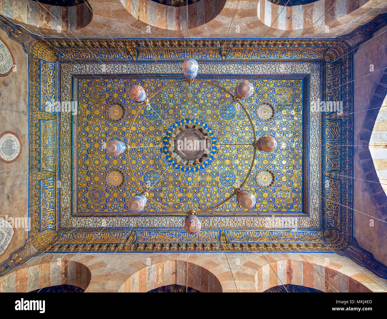 Ornate ceiling with blue and golden floral pattern decorations at Sultan Barquq mosque, Al Moez Street, Cairo, Egypt - Stock Image