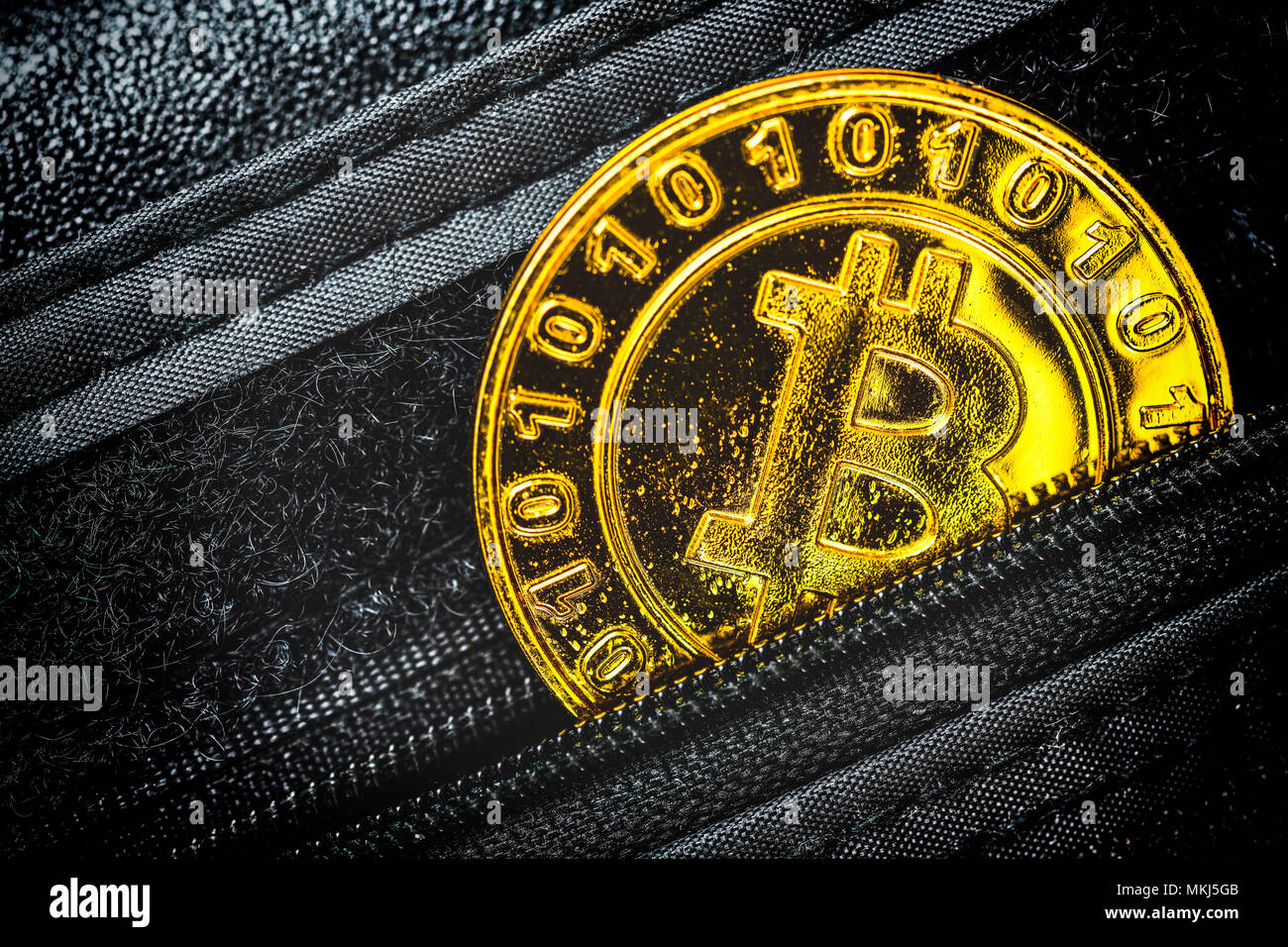 Coin with bitcoin characters in a wallet, Münze mit Bitcoin-Zeichen in einem Portemonnaie Stock Photo