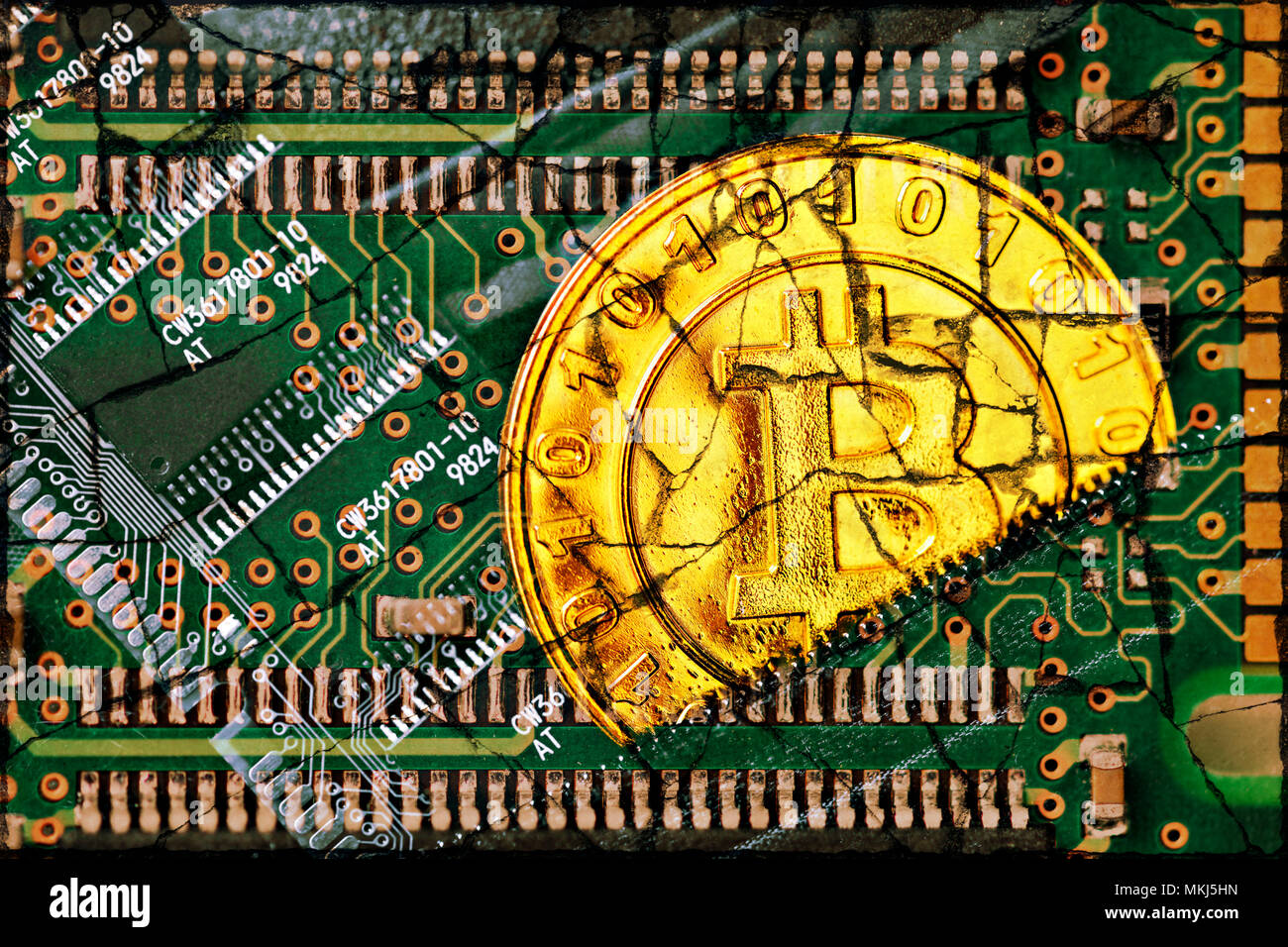 Coin with bitcoin characters and computer circuit board with cracks, loss in value of the crypto-Currency Bitcoin, Münze mit Bitcoin-Zeichen und Compu Stock Photo