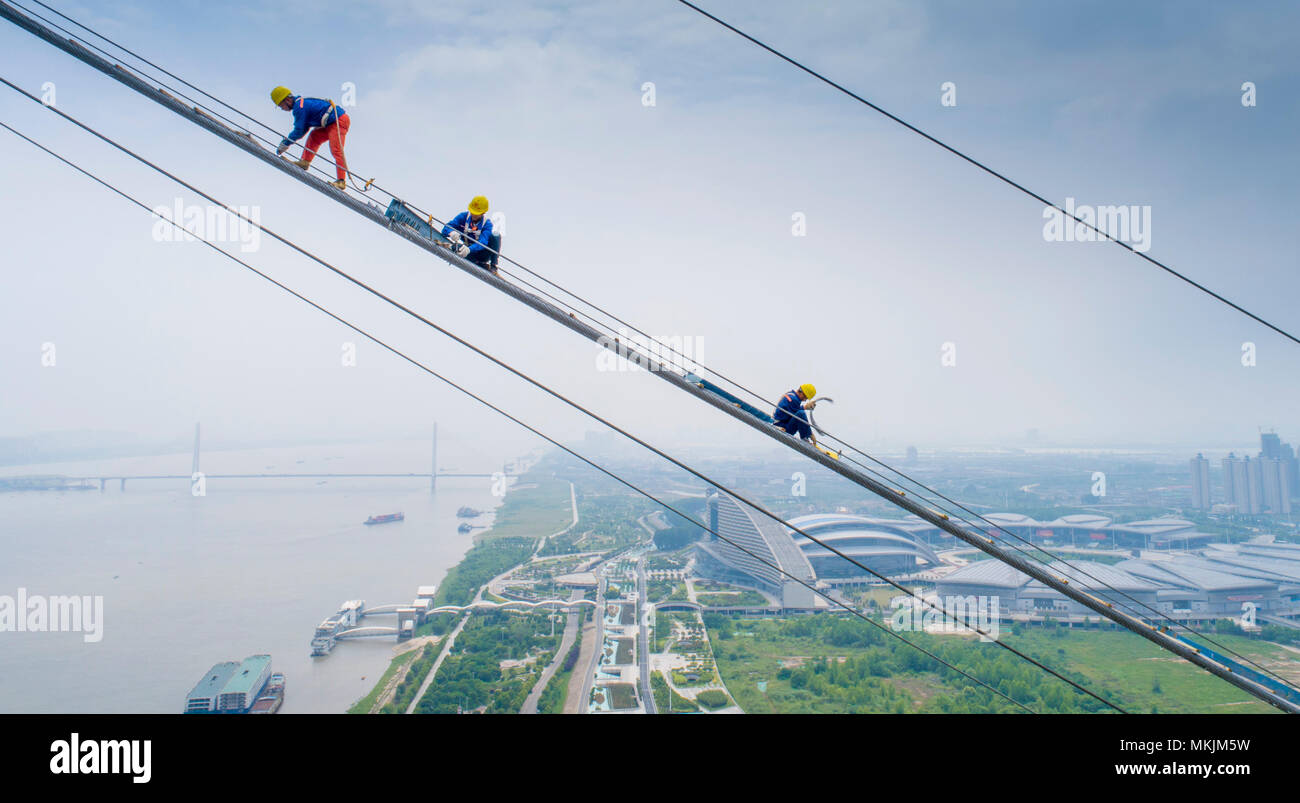Wuhan, China\'s Hubei Province. 8th May, 2018. Workers install wire ...