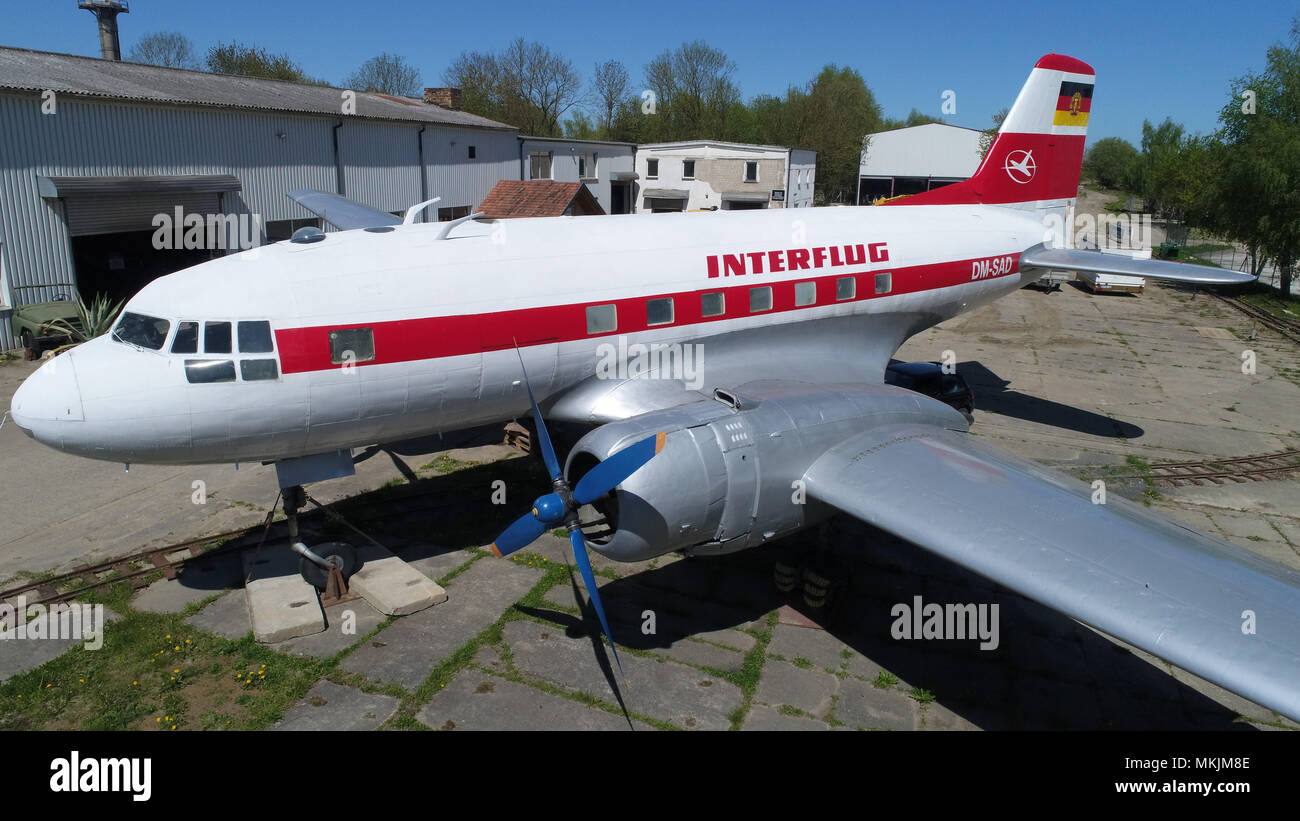 07.05.2018, Mecklenburg-Vorpommern, Grimmen: A plane of the type Iljuschin Il-14 has been in the technical park since May. The twin-engine classic car is one of a total of 80 in the 1950s and 1960s in the aircraft factory Dresden built Ilyushin of this type. The technology park was opened in 2010. On 10.05.2018 a tractor classic car meeting is planned in the technology park. (Aerial view with a drone) Photo: Stefan Sauer/dpa central image/dpa     (c) ZB-FUNKREGIO OST - free of charge only for recipients of the ZB-Regiodienstes       usage worldwide - Stock Image
