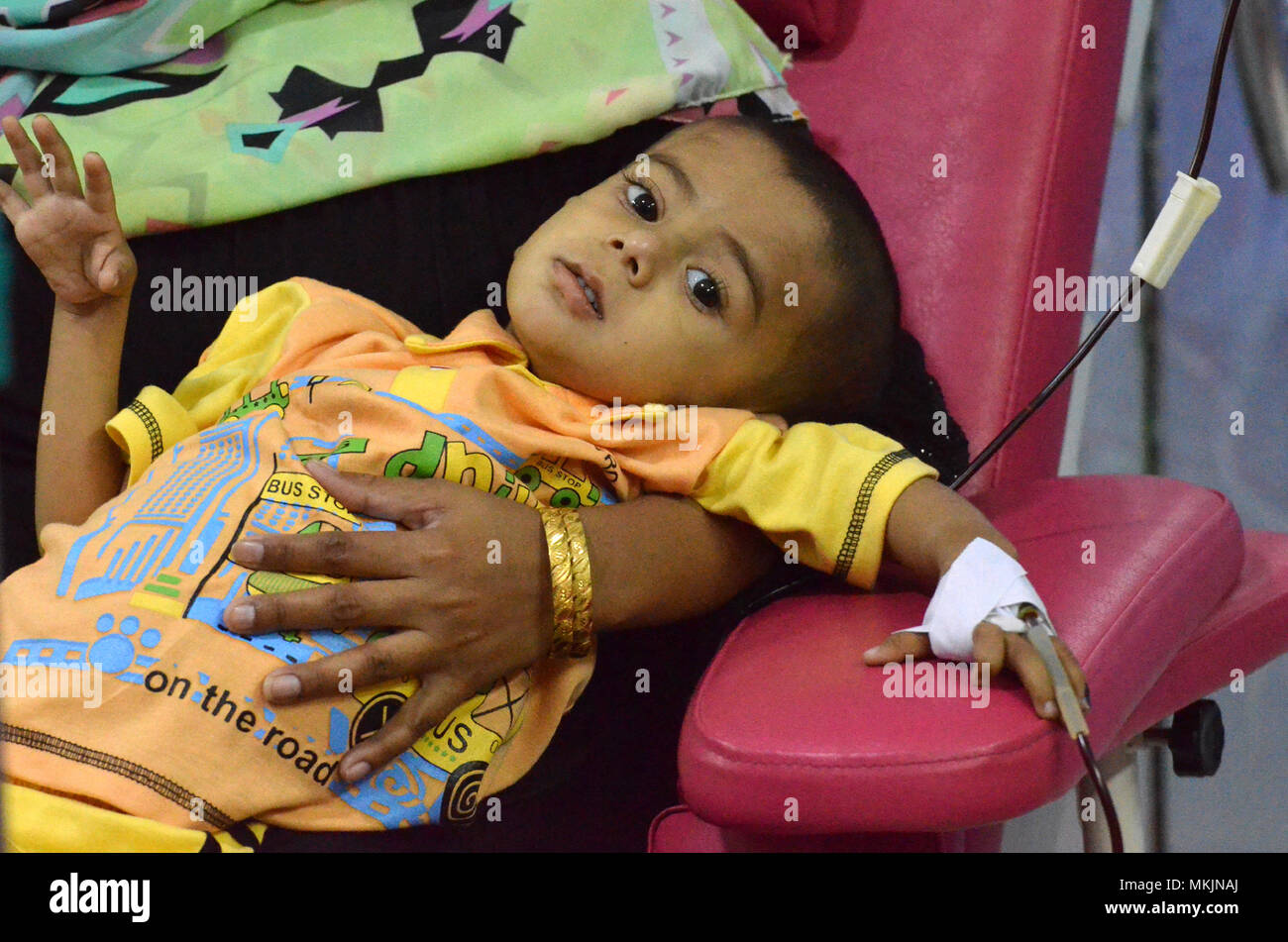 (180508) -- LAHORE, May 8, 2018 (Xinhua) -- A Pakistani patient suffering from thalassemia receives blood at a medical center on World Thalassemia Day in eastern Pakistan's Lahore on May 8, 2018. Thalassemia, also called Mediterranean anemia, is an inherited and non-infectious blood disorder. (Xinhua/Jamil Ahmed)(yk) - Stock Image