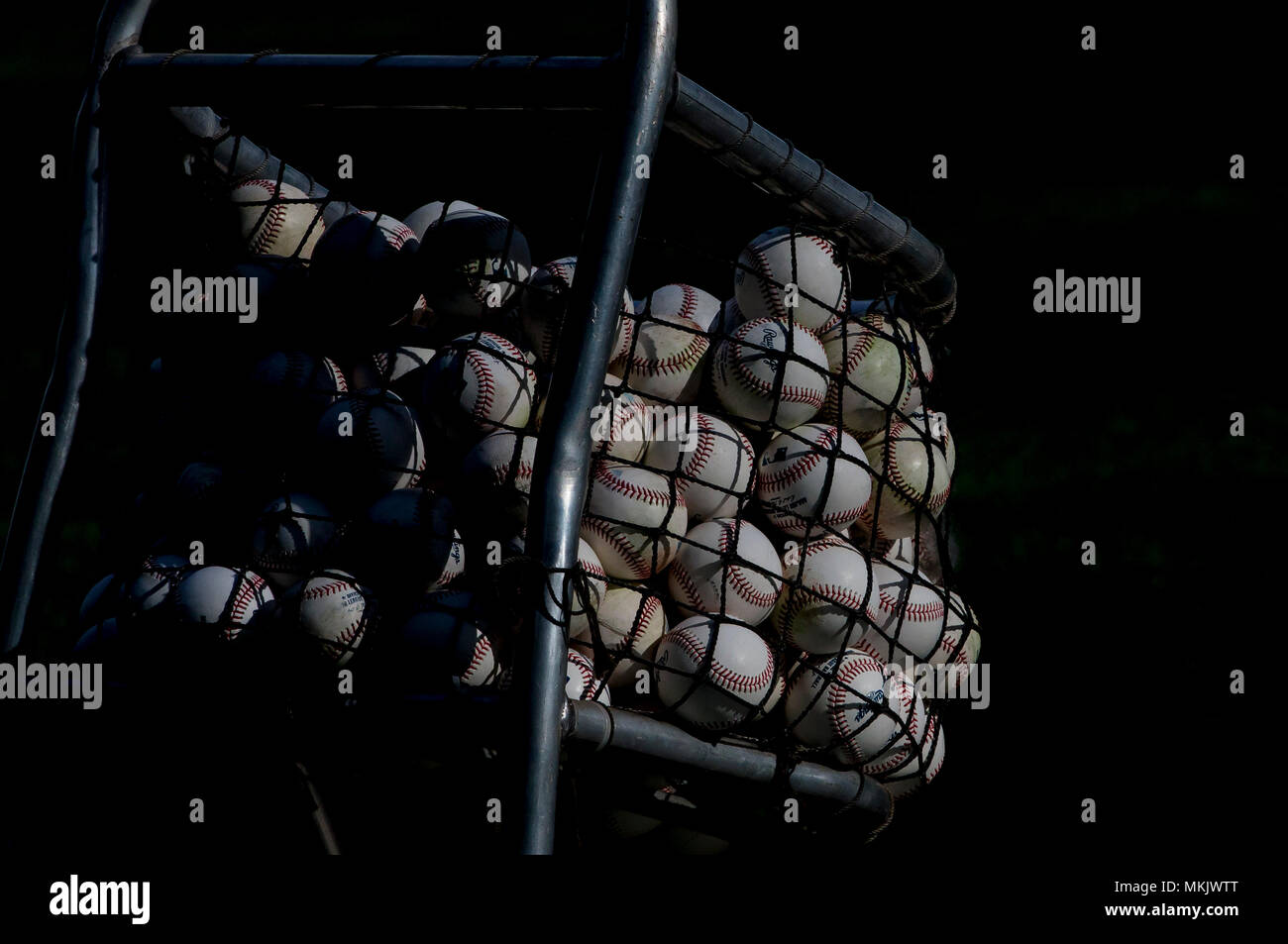 Milwaukee, WI, USA. 8th May, 2018. The sun shines through the side of Miller Park and on the ball cart while the Cleveland takes batting practice before the Major League Baseball game between the Milwaukee Brewers and the Cleveland Indians at Miller Park in Milwaukee, WI. John Fisher/CSM/Alamy Live News - Stock Image