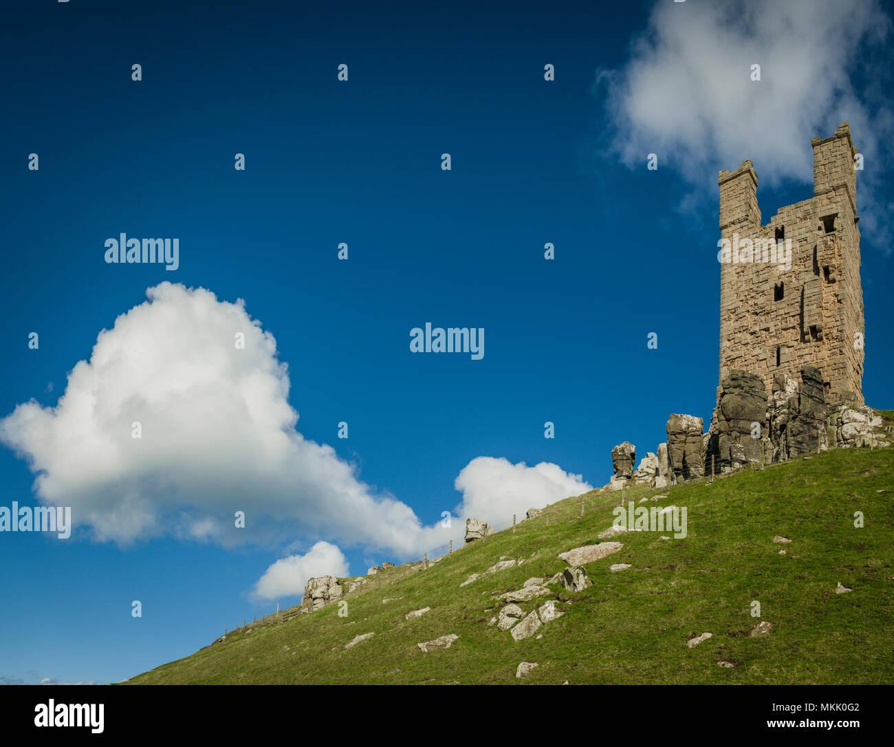 Lilburn Tower, Dunstanburgh Castle, Northumberland, UK. Stock Photo