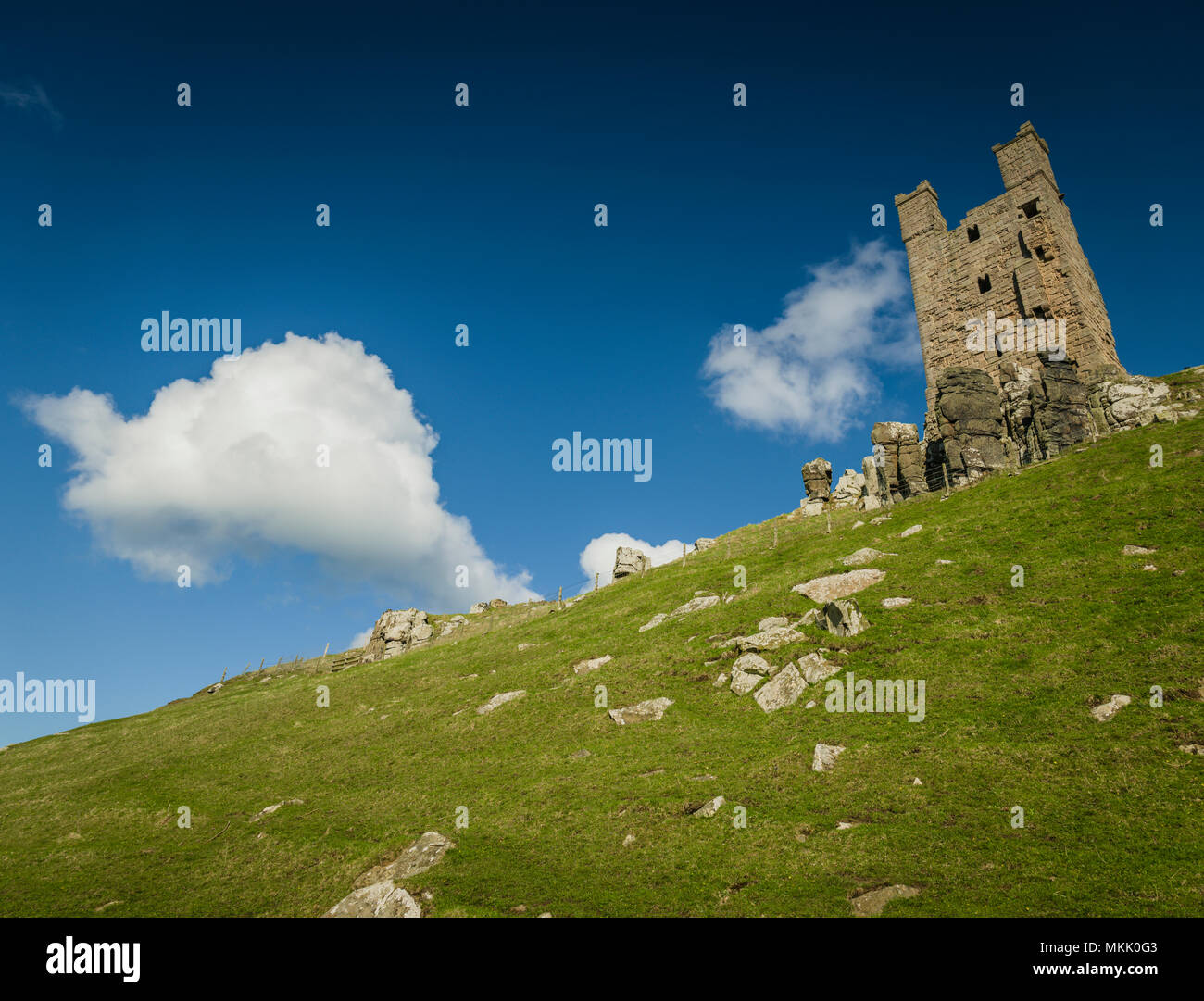 Lilburn Tower, Dunstanburgh Castle, Northumberland, UK. Stock Photo