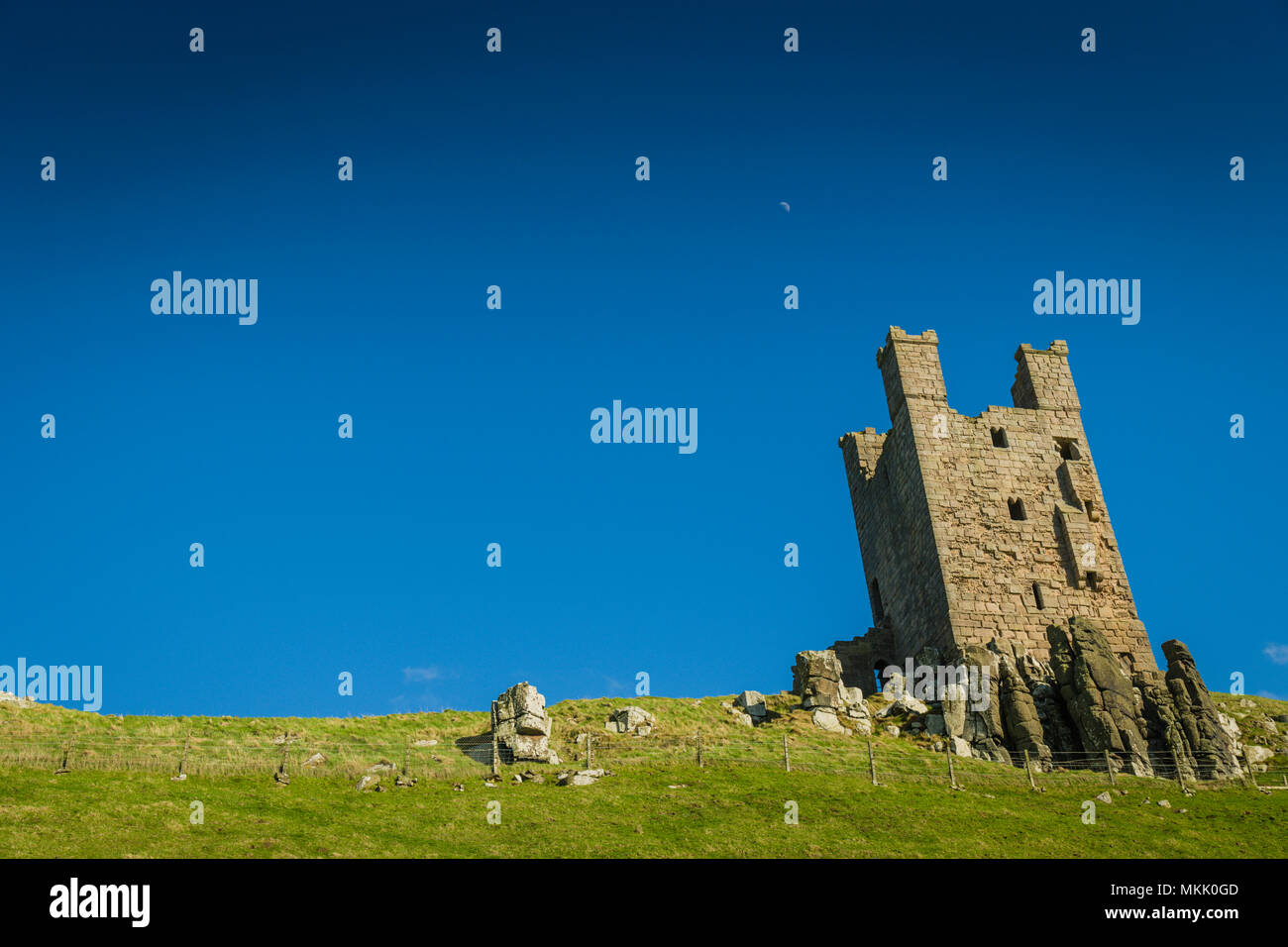Lilburn Tower, Dunstanburgh Castle, Northumberland, UK. - Stock Image