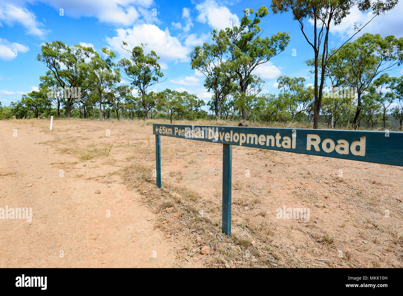 Road sign pointing to the direction of the Peninsula Developmental Road (PDR) on a remote dirt road, Far North Queensland, FNQ, QLD, Australia - Stock Image
