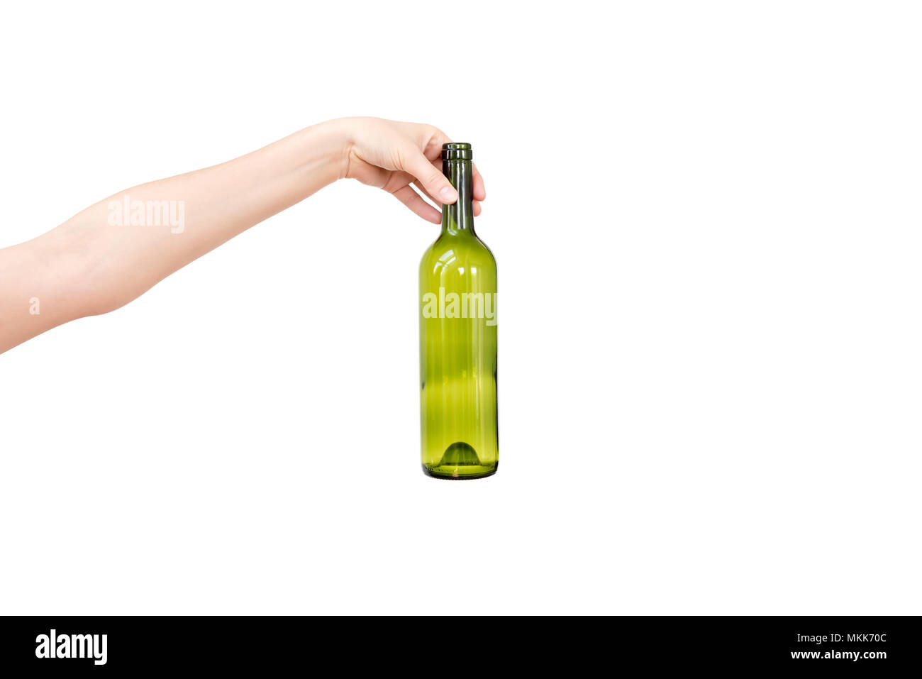 Female hand holding empty glass bottle isolated on white. Recyclable waste. Recycling, reuse, garbage disposal, resources, environment and ecology con - Stock Image