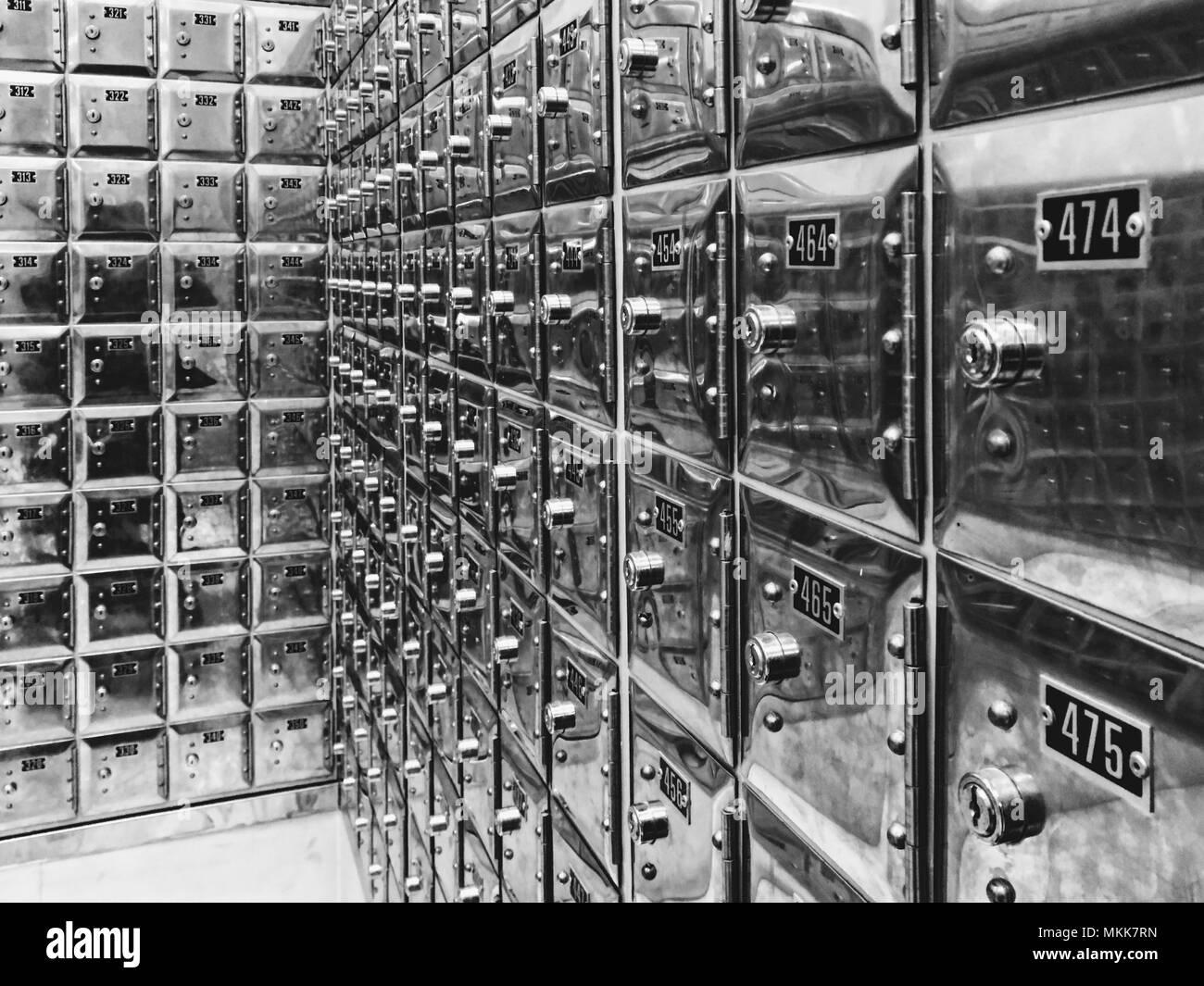 Storage of metallic numbered boxes - Stock Image