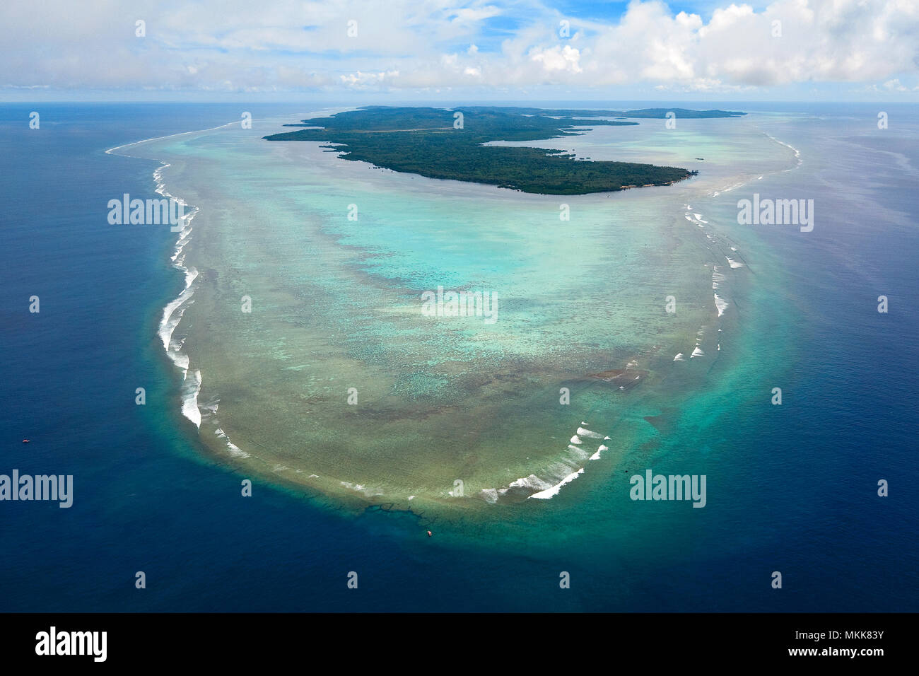 Yap Island. southern end, reef, lagoon, waves, corals, clouds, pacific ocean, sea view, drone photography, bird's eye view, Yap, Caroline Islands, Fed - Stock Image