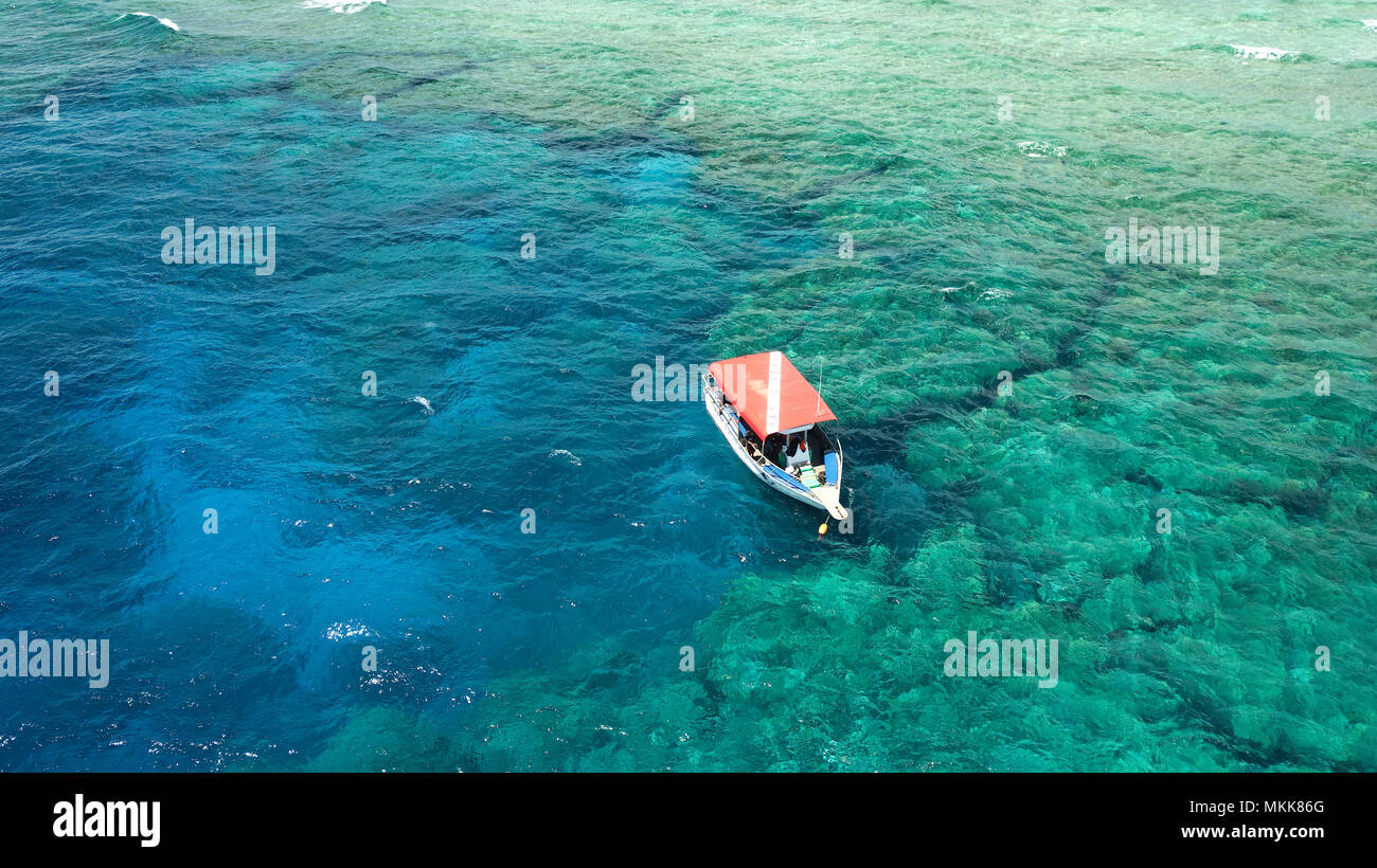 dive boat, Yap Island, southern end, reef, lagoon, waves, corals, pacific ocean, sea view, drone photography, bird's eye view, Yap, Caroline Islands,  - Stock Image