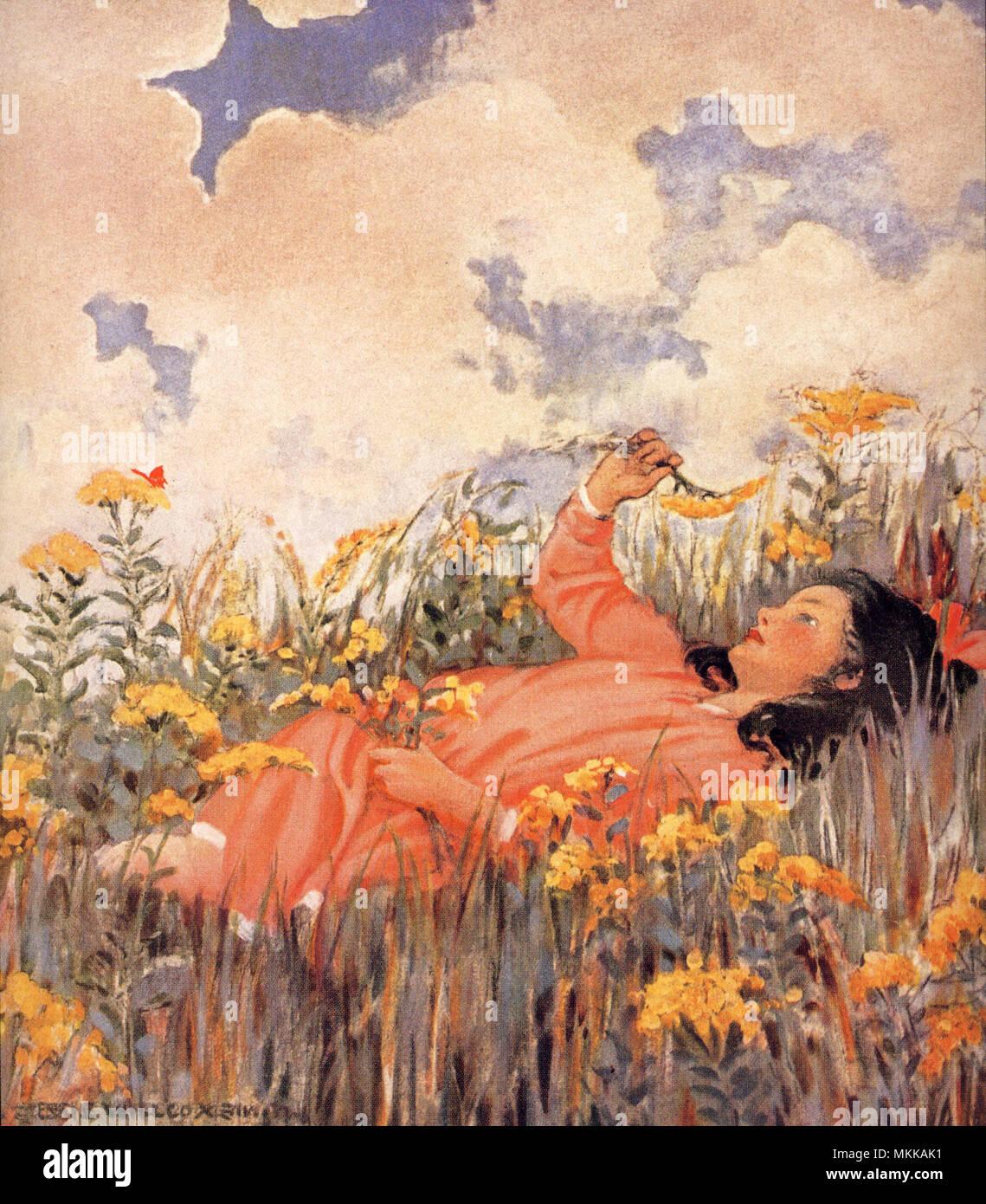Girl Lying in Grass Stock Photo - Alamy