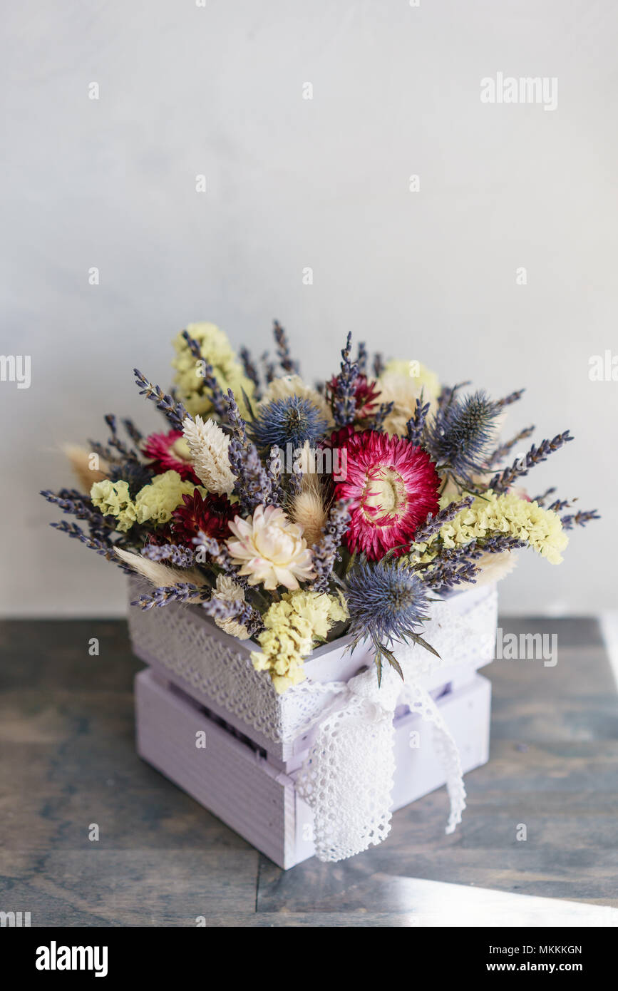 beautiful mini bouquet lavender and dry flowers on table Stock Photo ...