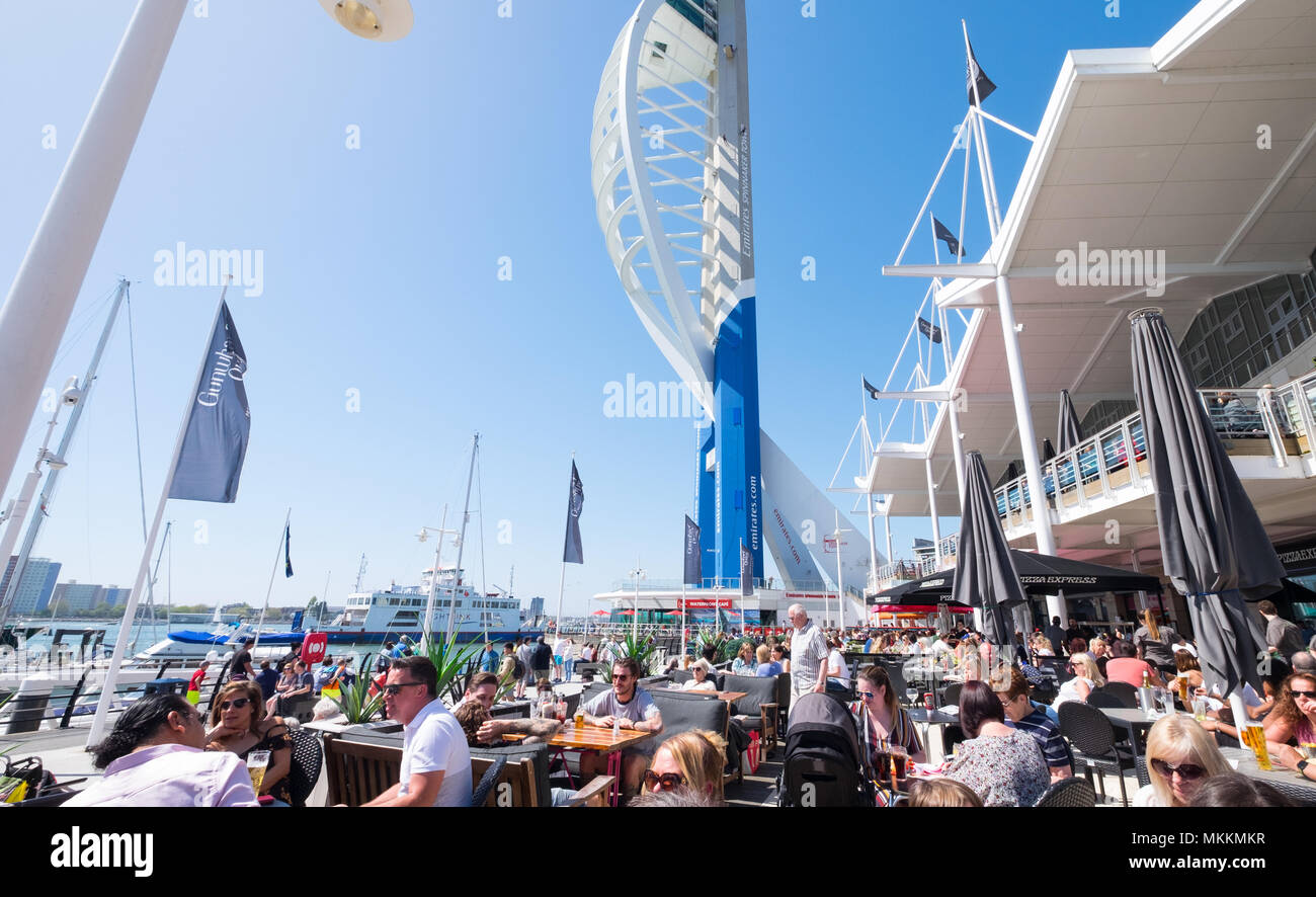 People drinking and dining in the sunshine at Gunwharf Quays in Portsmouth - Stock Image