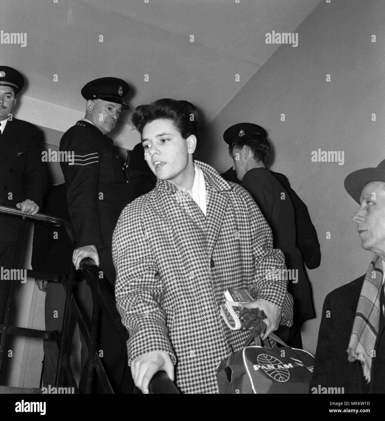 Cliff Richard pictured at London Airport, leaving for New York. 18th January 1960. - Stock Image