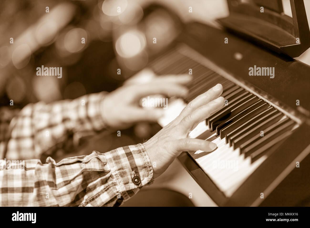 DIMITROVGRAD, BULGARIA - APRIL 30, 2018: Hands of male pianinst play
