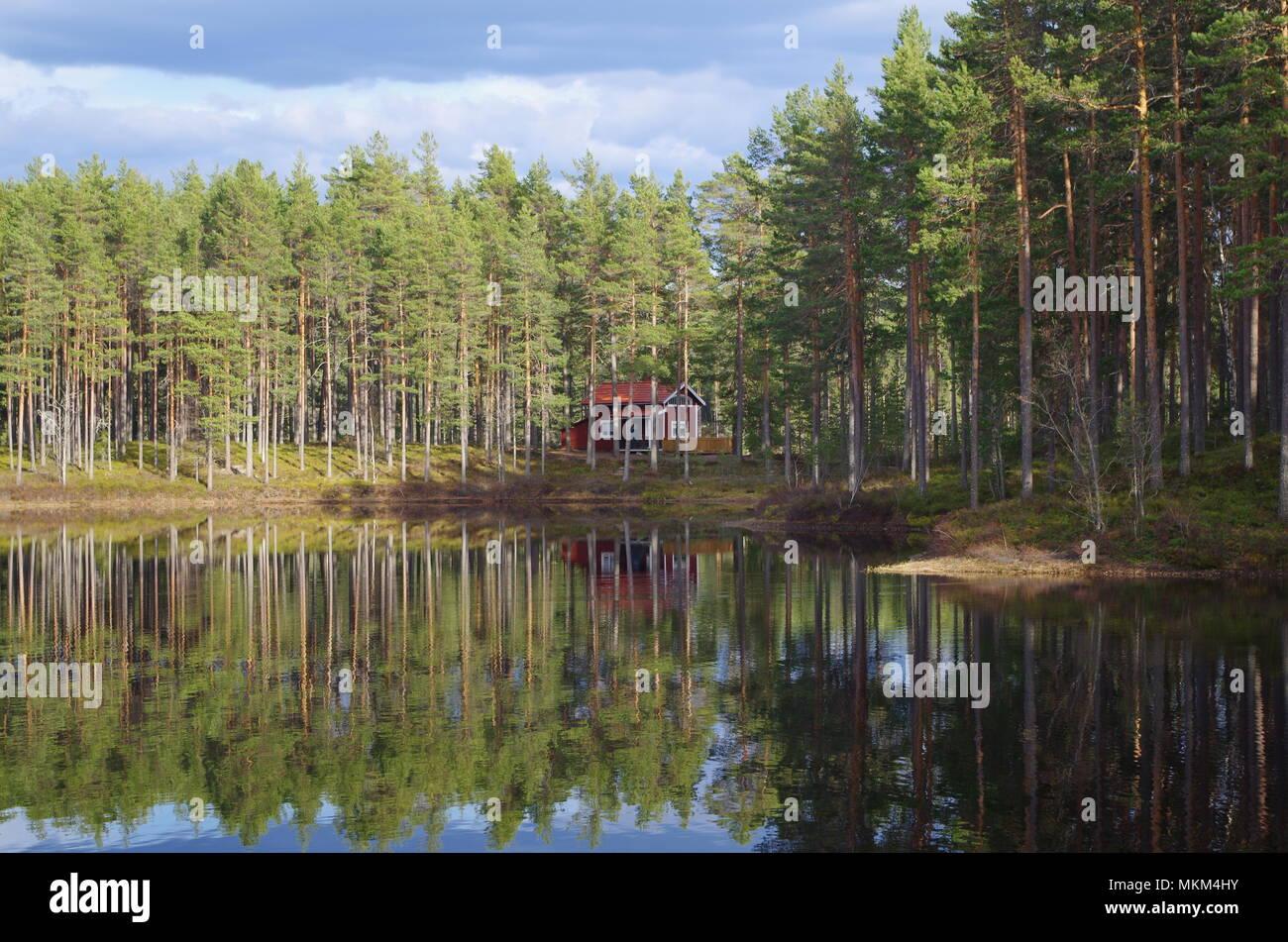 Summer house on a beautiful lake in Dalarna - Stock Image