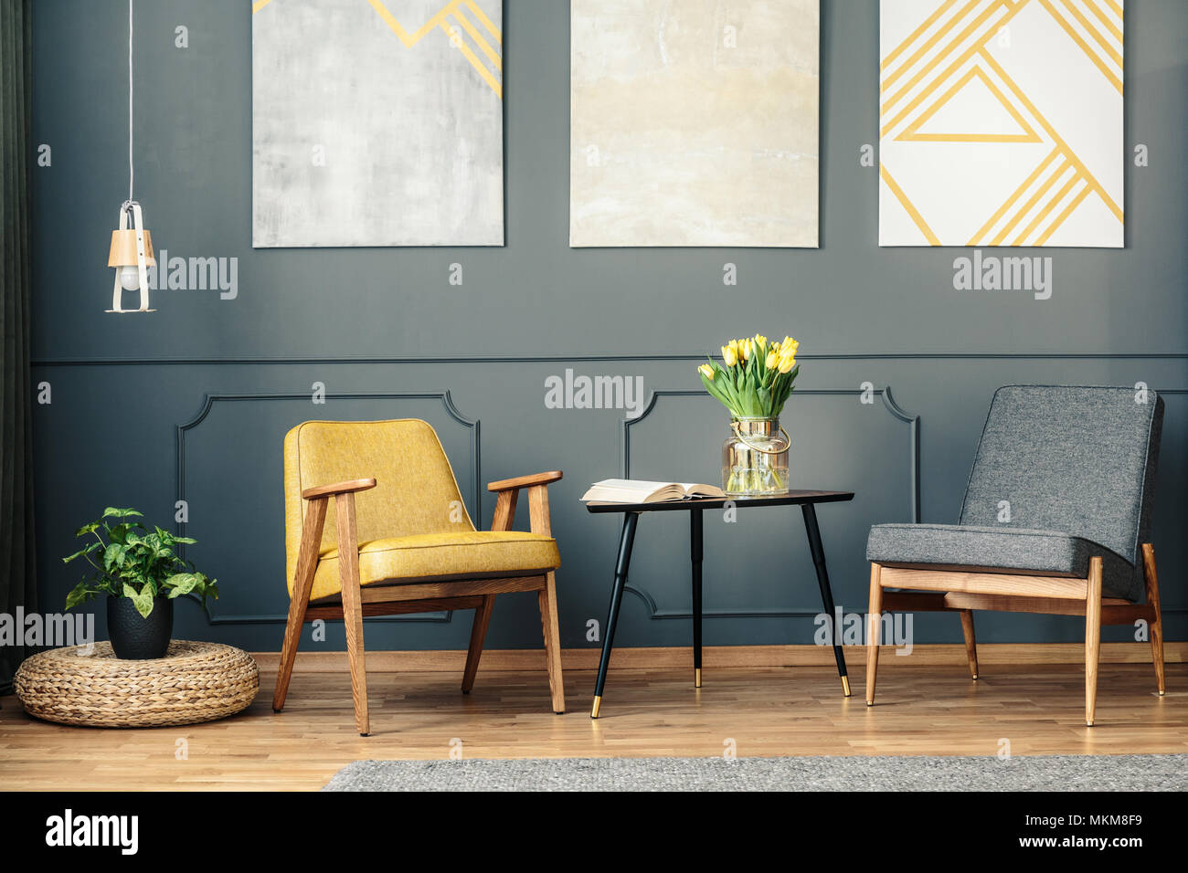 Retro Chairs In Vintage Living Room Interior With Paintings Lamp Plant And Book On The Table Stock Photo Alamy