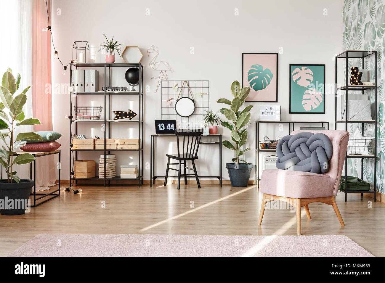 Sun Beams Illuminating A Modern Home Office In A Trendy Living Room  Interior With Industrial Furniture And Pink Elements