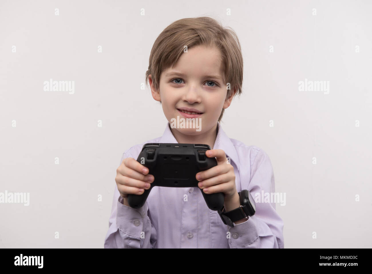 Happy delighted boy playing games - Stock Image