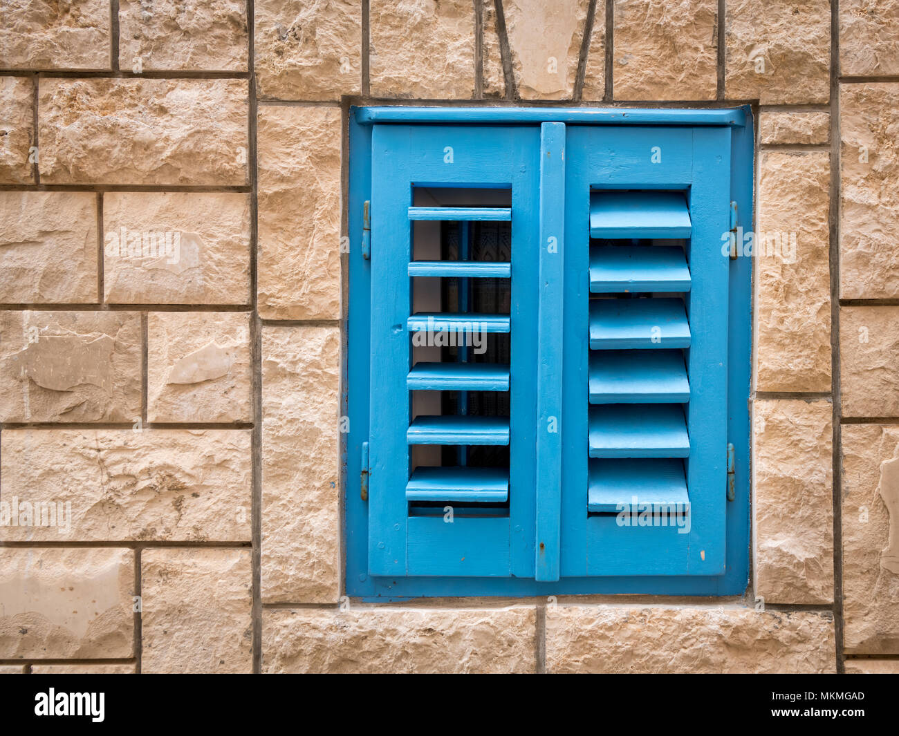 Colorful Blue Shutters Of A Small Window In Croatia Island