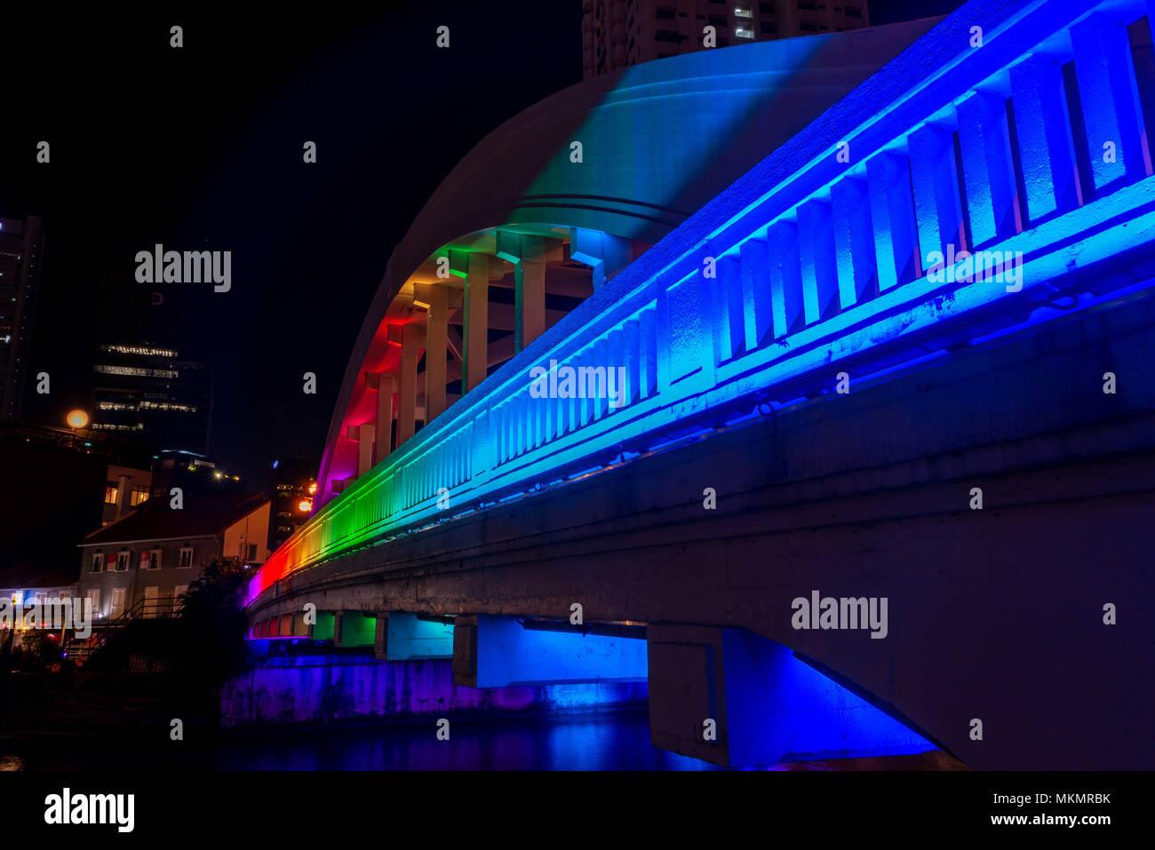 Rainbow colors on the Elgin Bridge in Singapore at night - Stock Image
