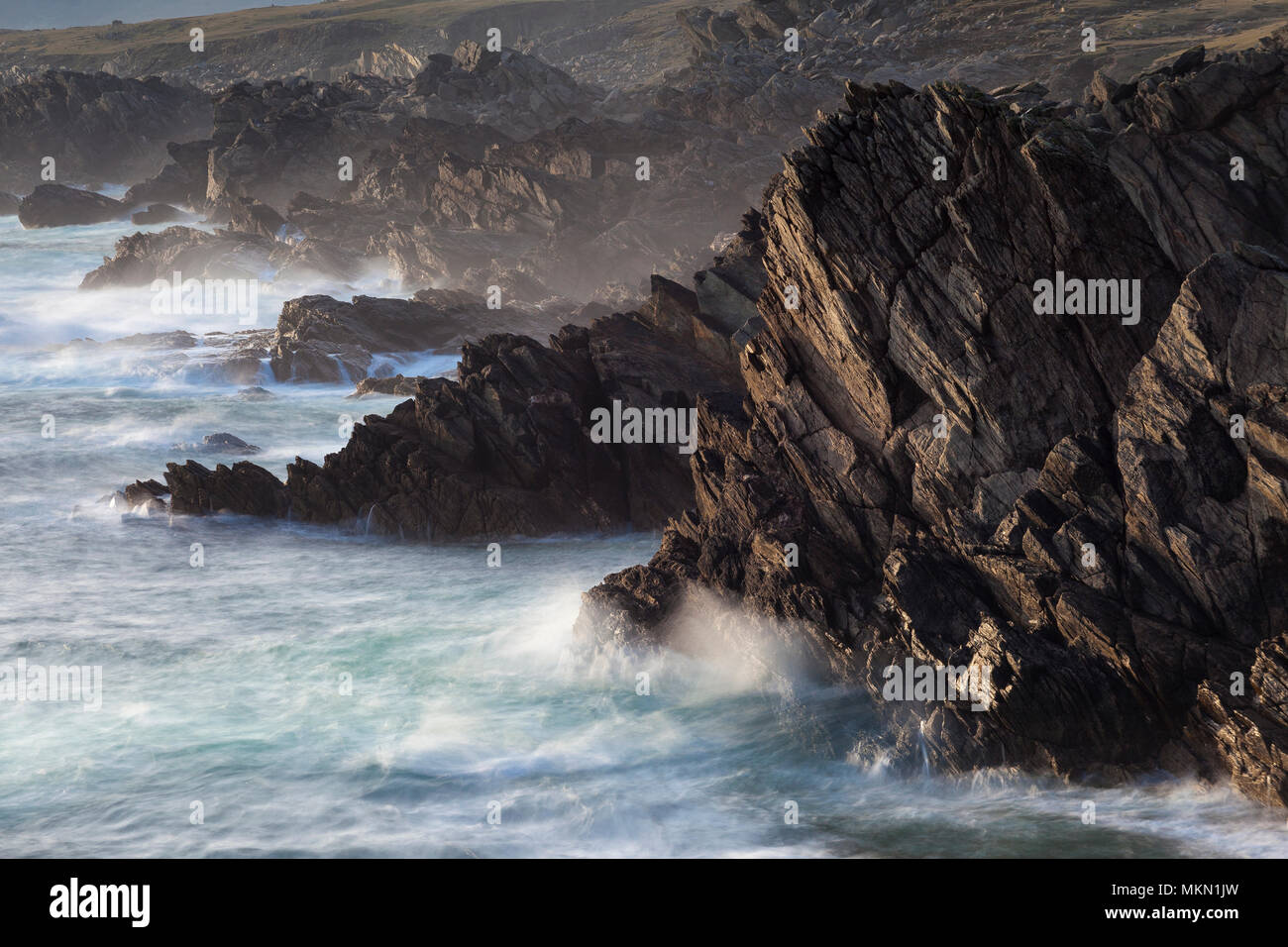 Waves crashing on the rocky coastline of Achill Island a destination on the Wild Atlantic Way  County Mayo Ireland - Stock Image