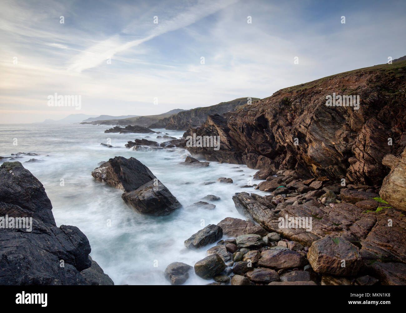 Coastline of Achill Island a destination in County Mayo with dramatic skies and waves breaking. - Stock Image